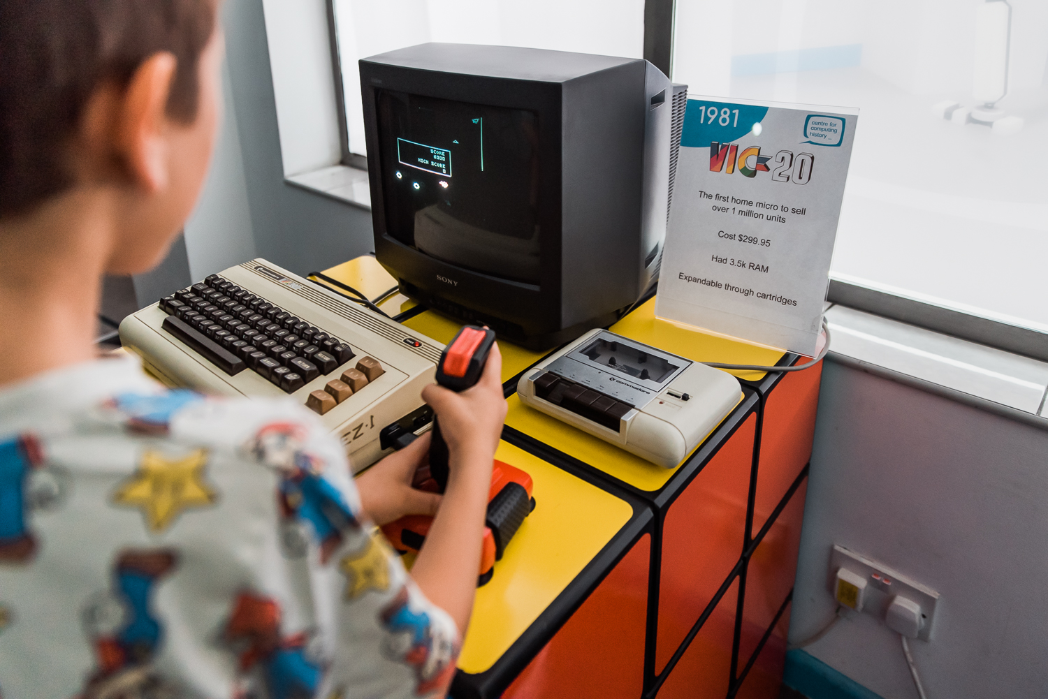 Playing computer game on the Vik-20 in the Museum of Computing History
