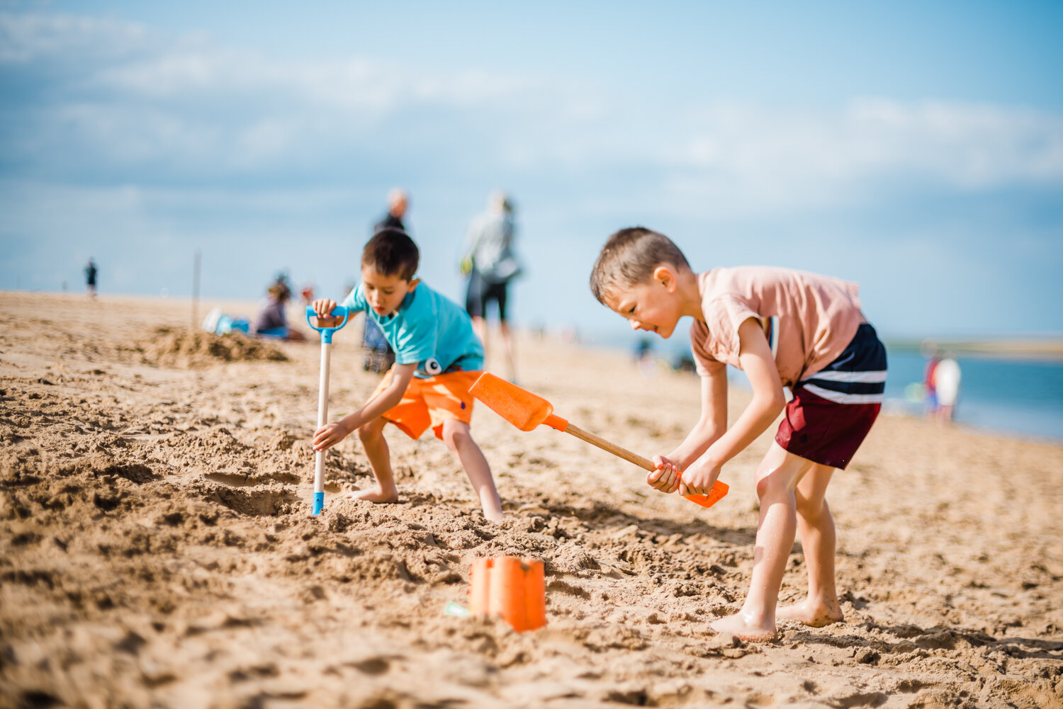 Bucket and spade, sandcastle building, family photography on the beach at Wells-next-the-Sea, Norfolk.