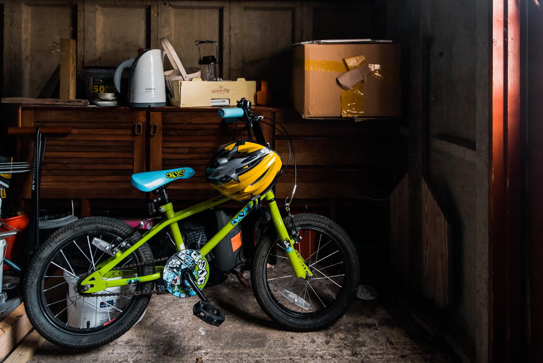 Green bike in a shed