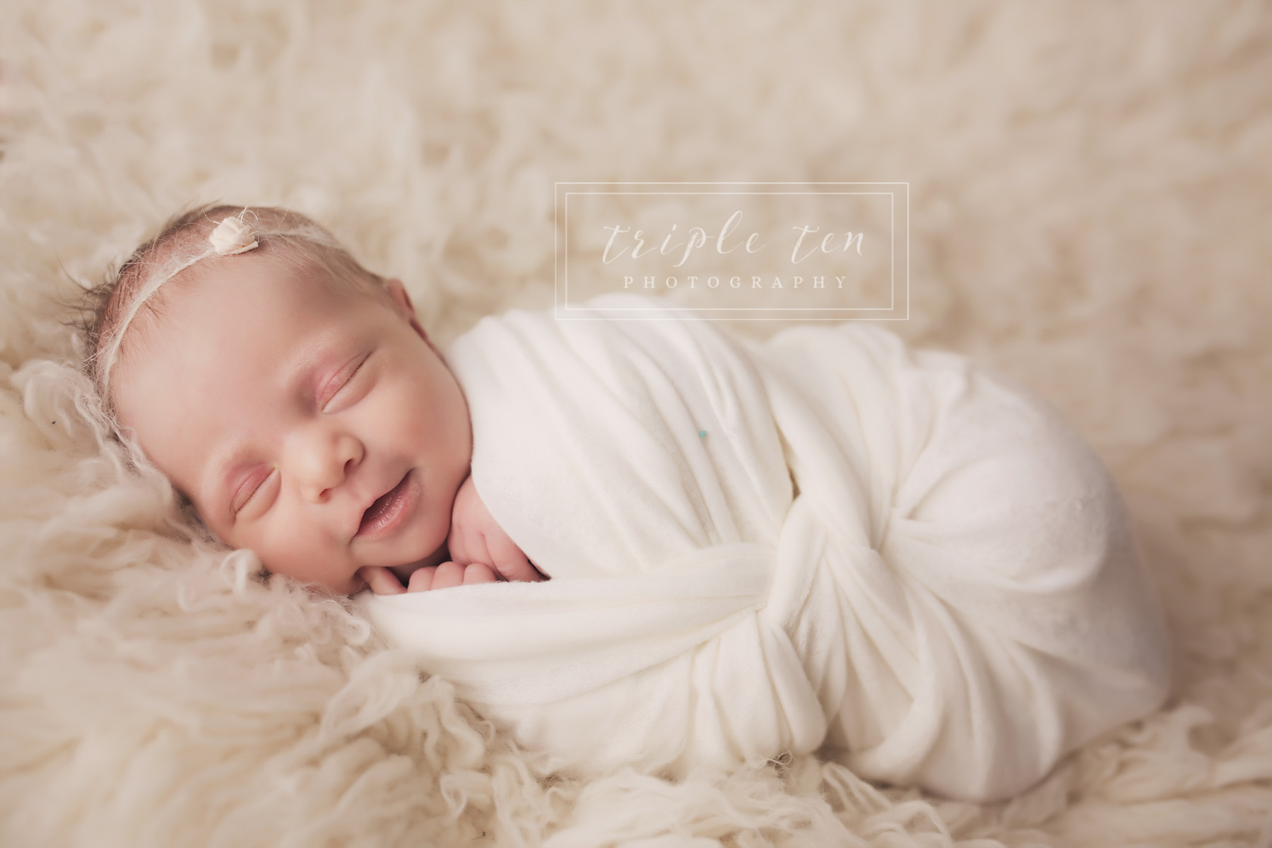 smiling baby photo red deer newborn photographer.jpg