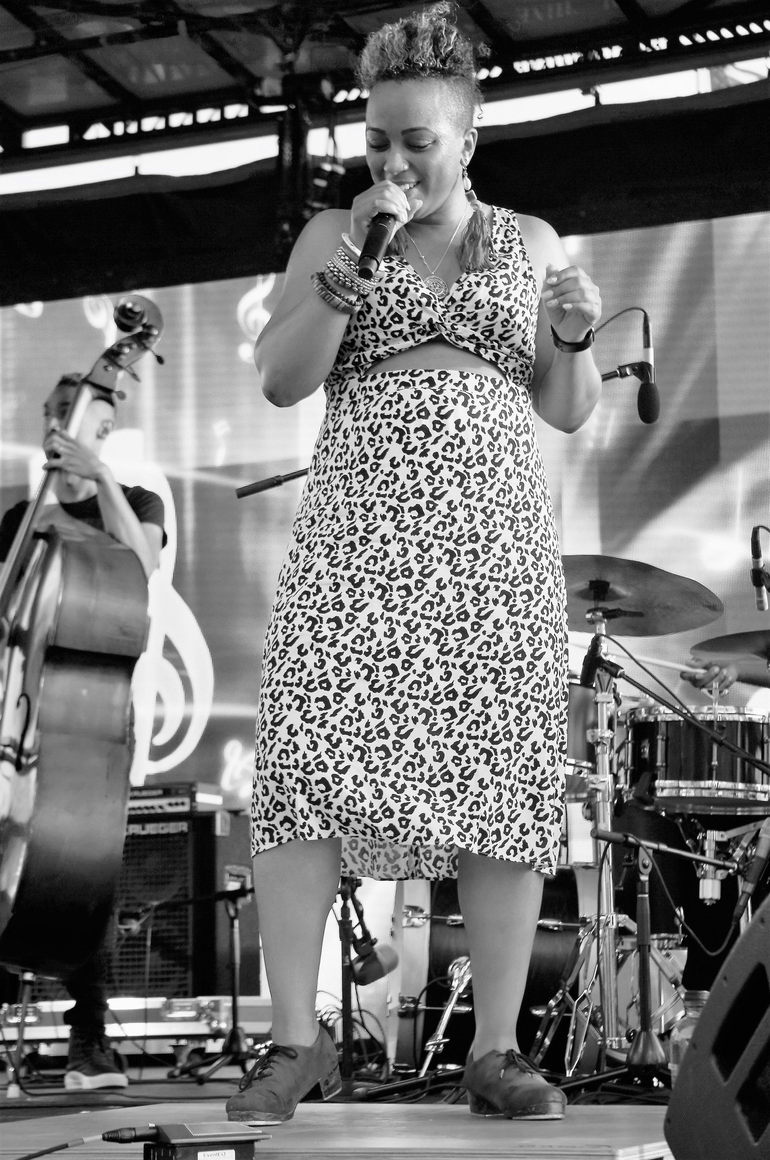 tap dancer Brinae Ali performing with Sean Jones' Dizzy Spellz at The Wharf on 6/16/19 (photo by Bridget Arnwine)