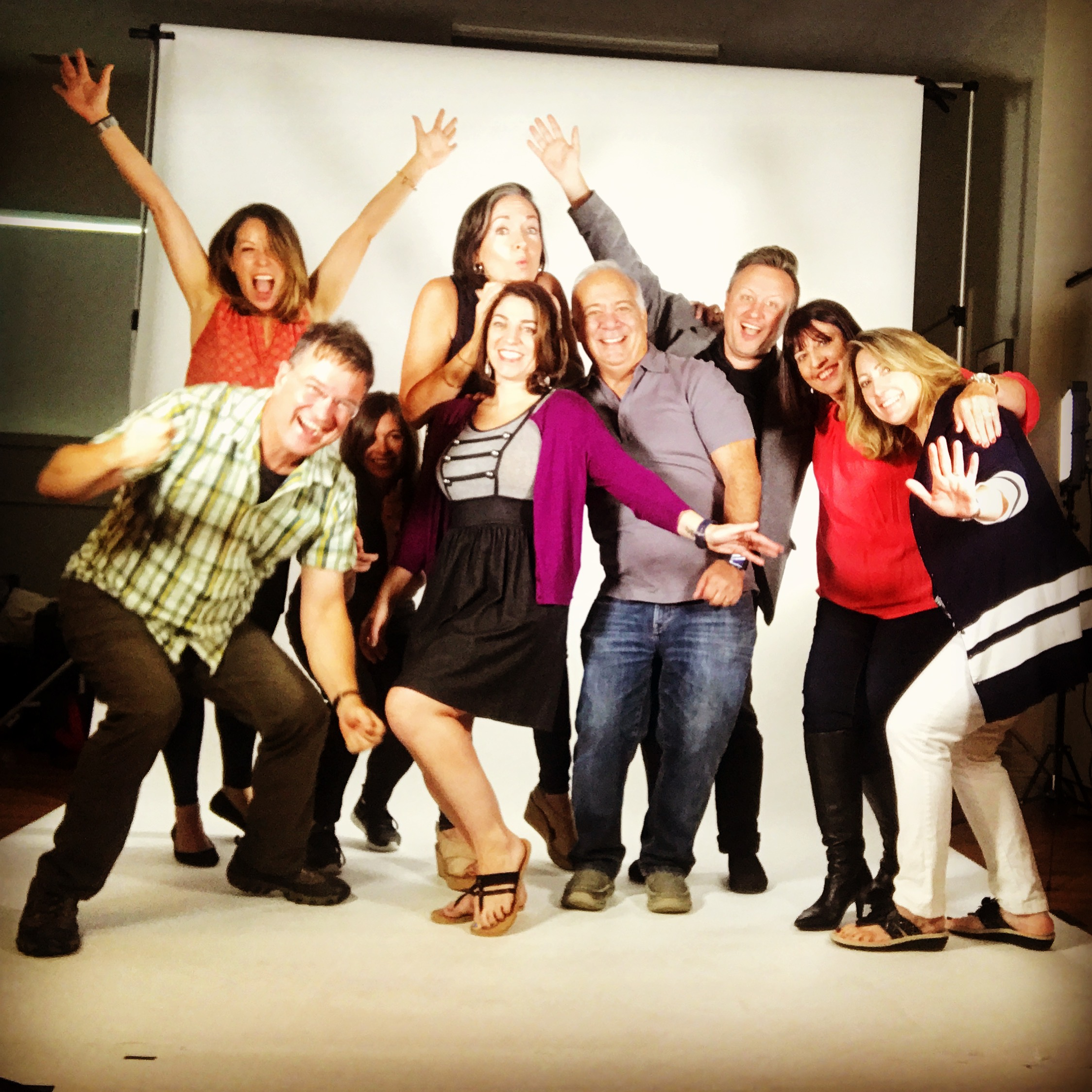 In a studio for a commercial photography project with lots of people on set, squeeze in and celebrate!