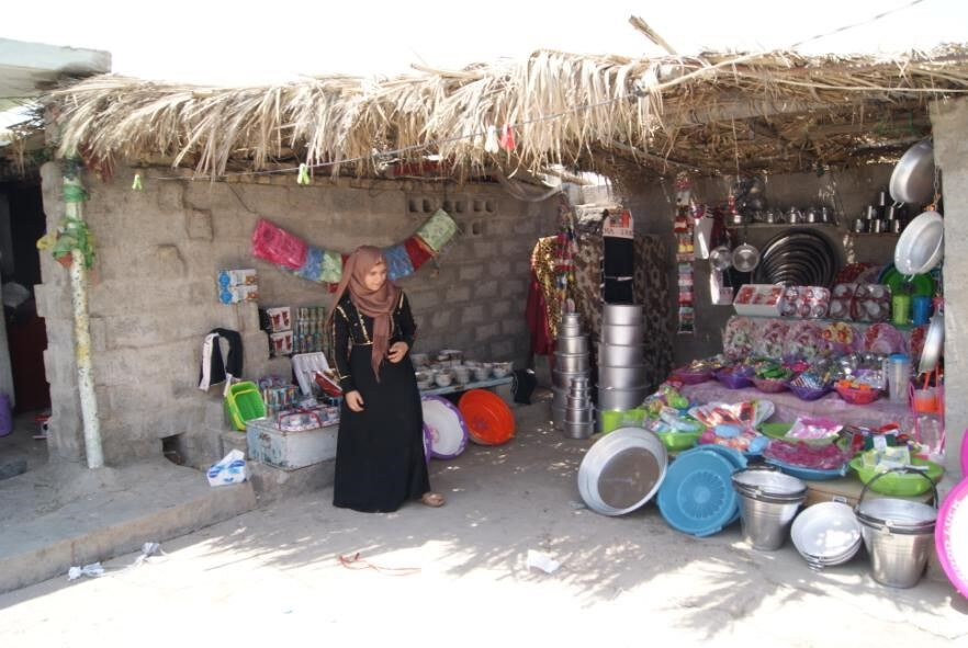 A young girl working in her new home business.