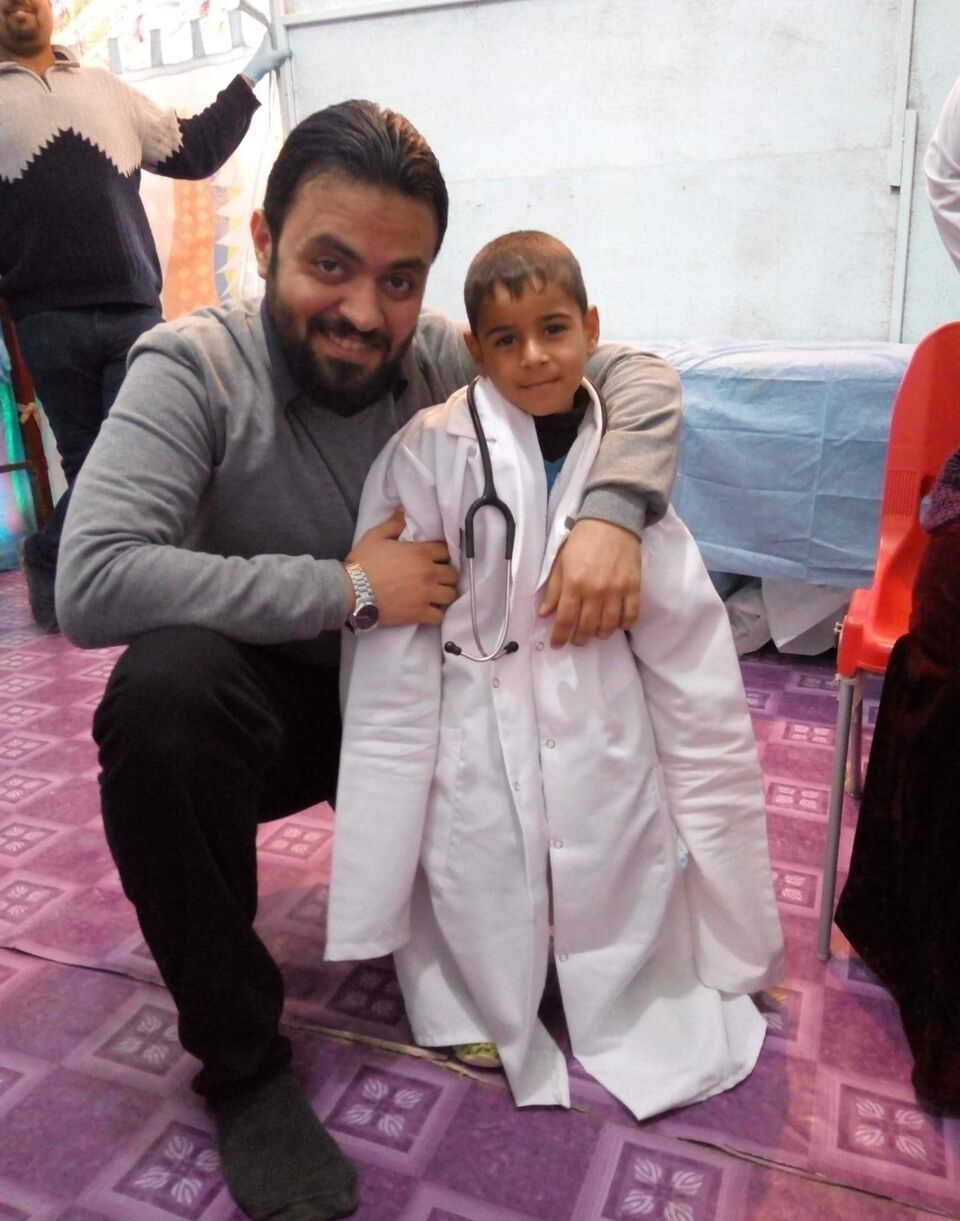 Dr Mustafa with little Dr. Moayad.jpg