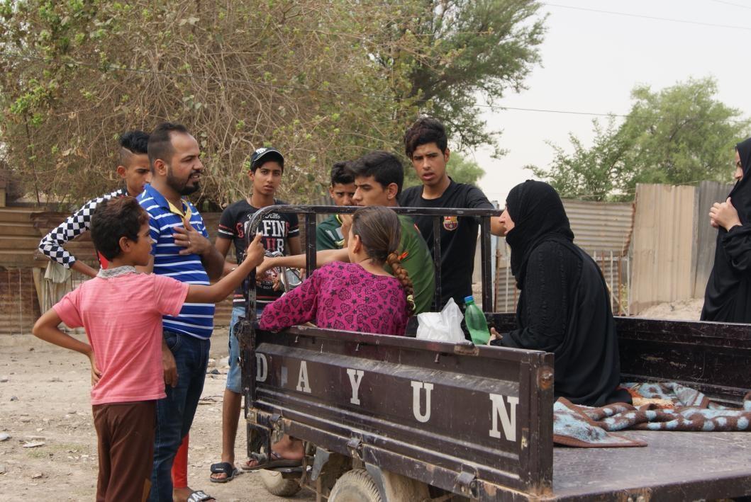 Talking to kids at displaced complex.jpg