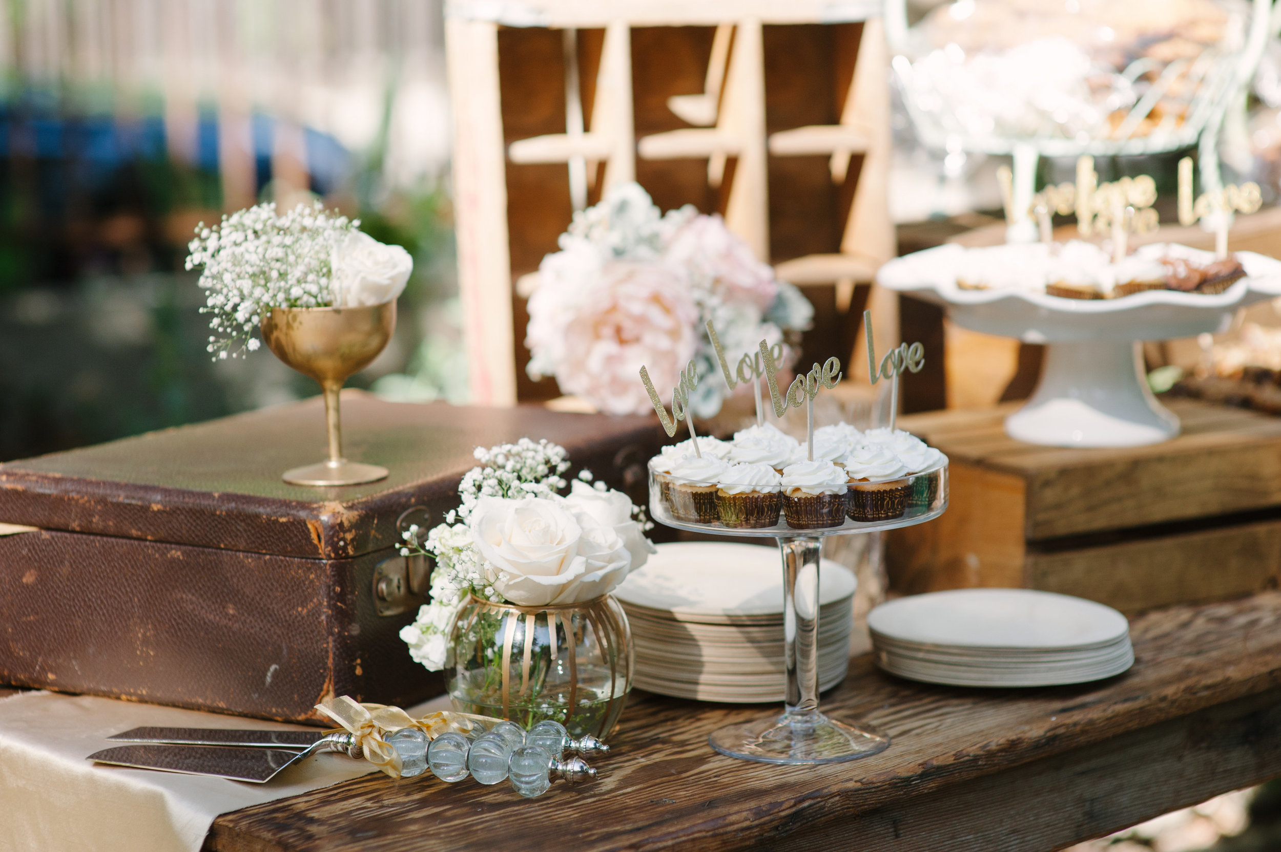 Dessert table styled for wedding reception.
