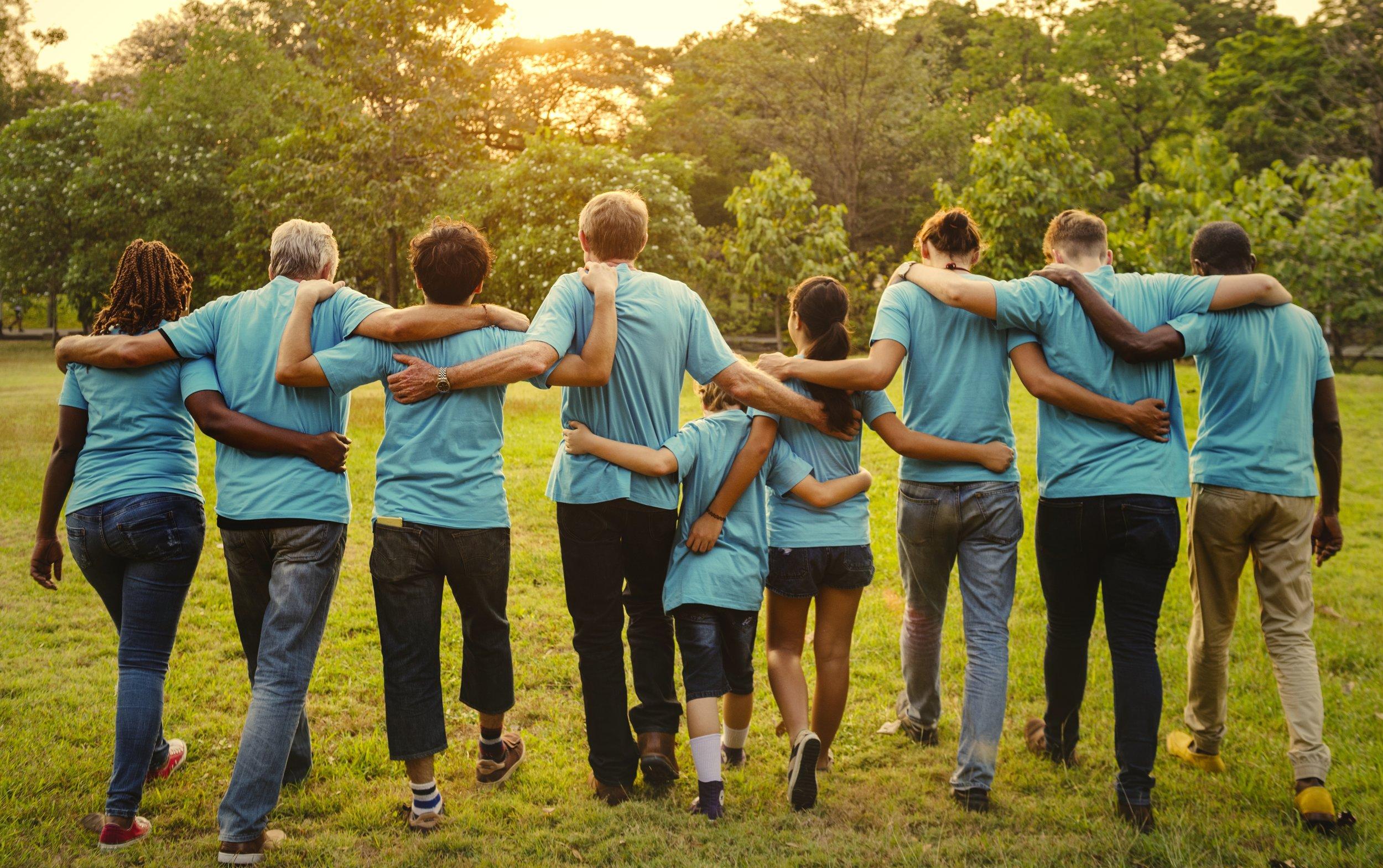 group-of-diversity-people-volunteen-arm-around-UDHZGYT.jpg