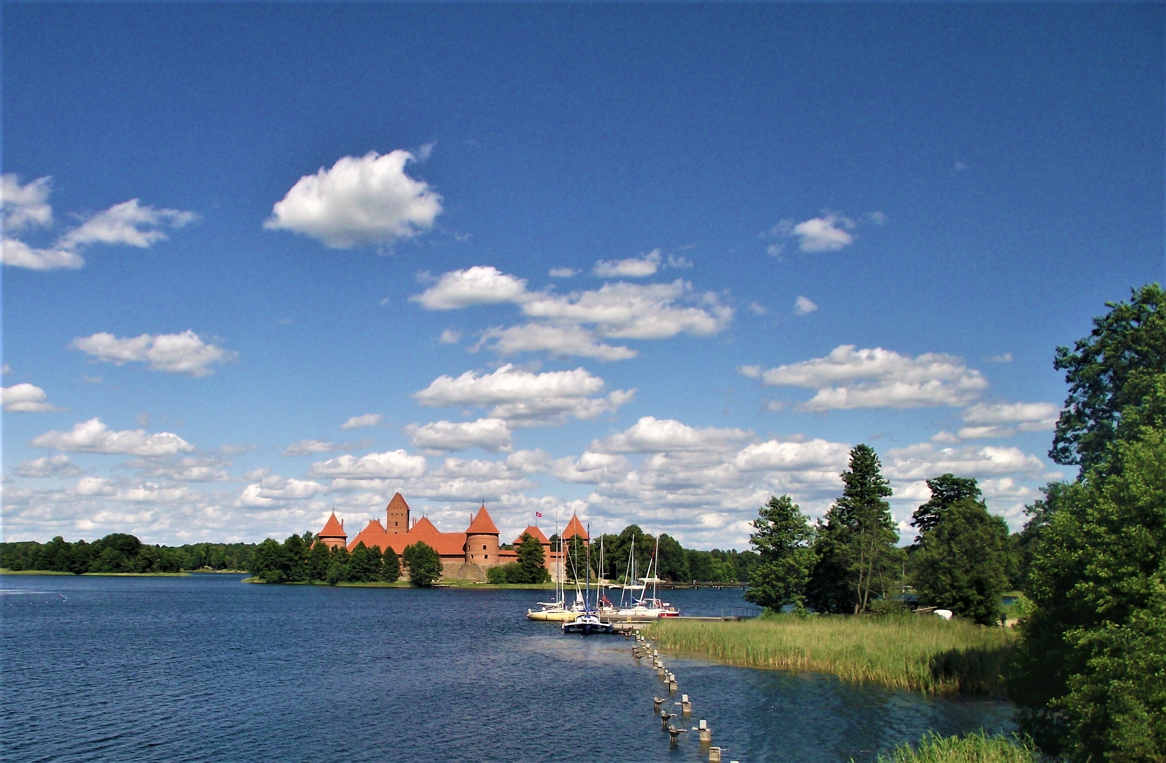 If you're looking for the best things to do in Lithuania Trakai Island Castle is one of the best places to visit on a road trip in the Baltics