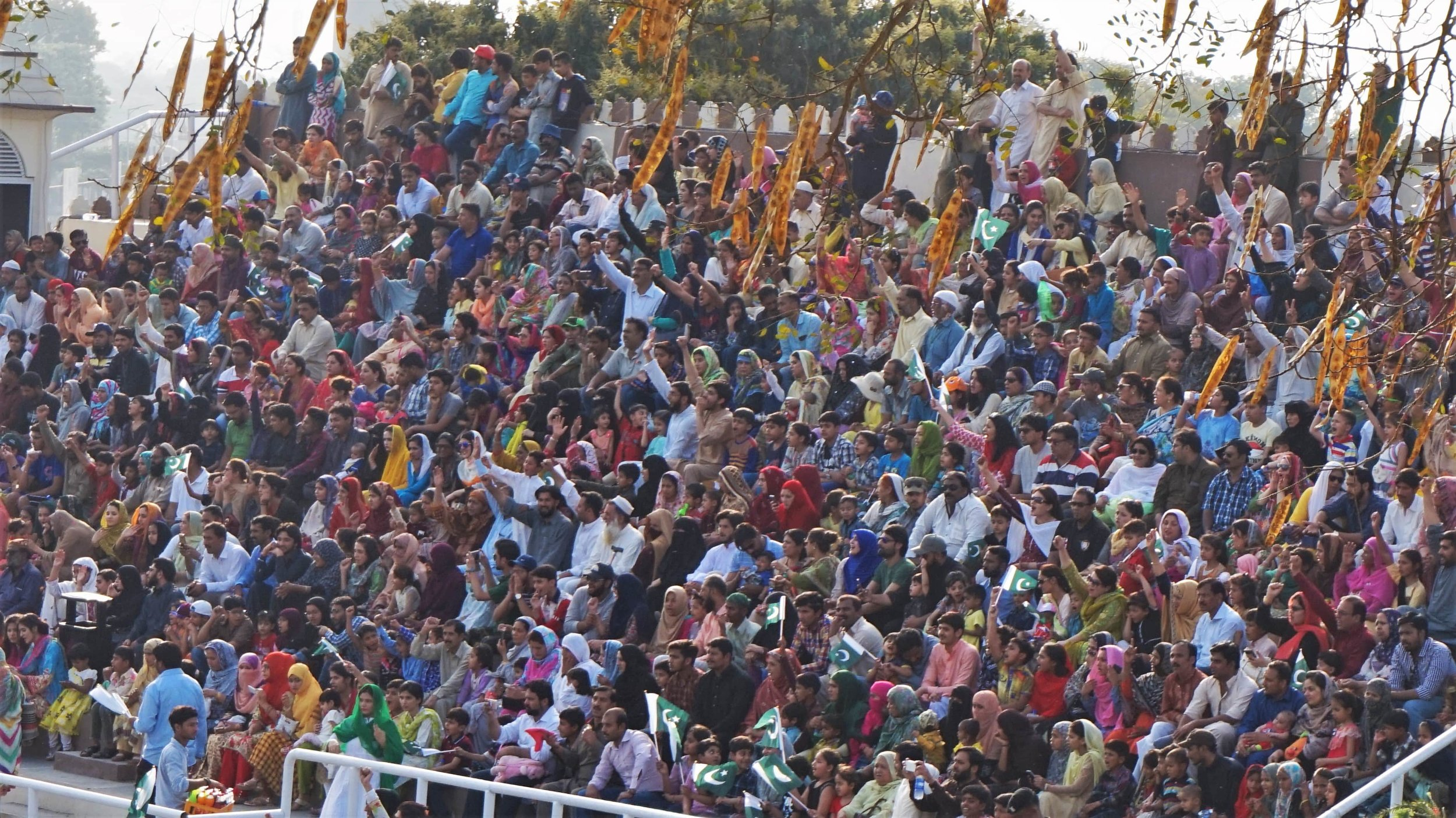 crowds on the pakistan side of the wagah border watching the Wagah border parade closing ceremony.