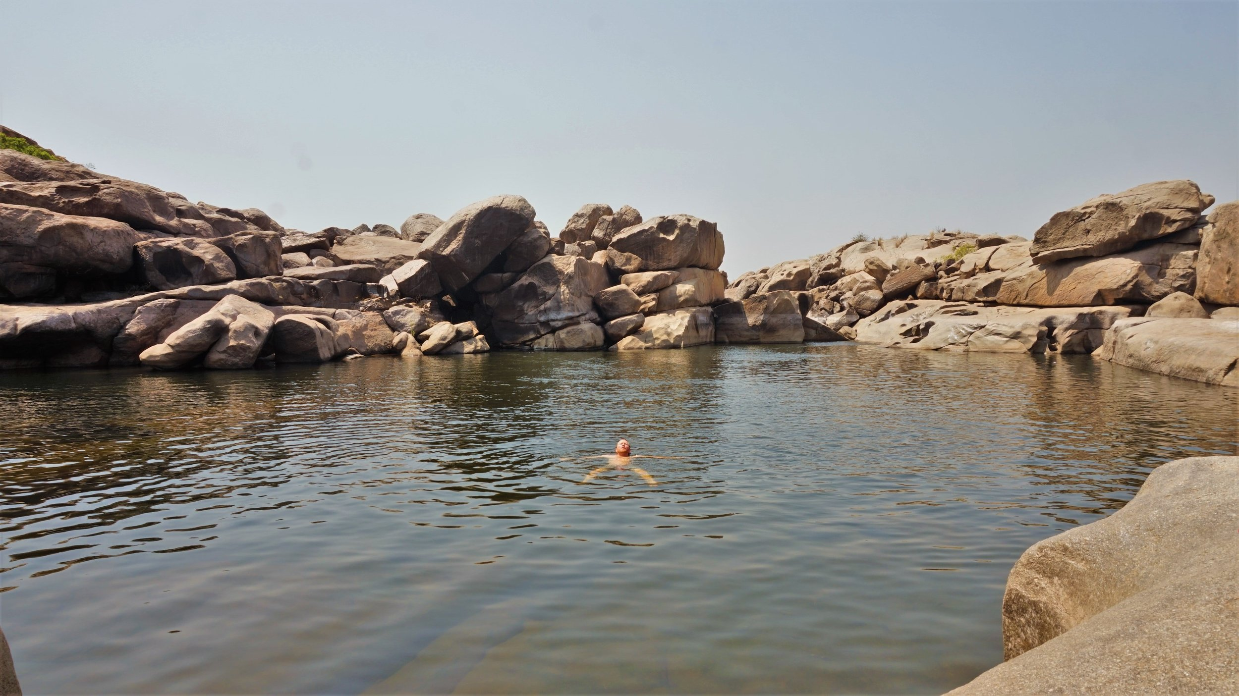 The Hampi waterfall is one of the best places to visit in Hampi for a refreshing bath.