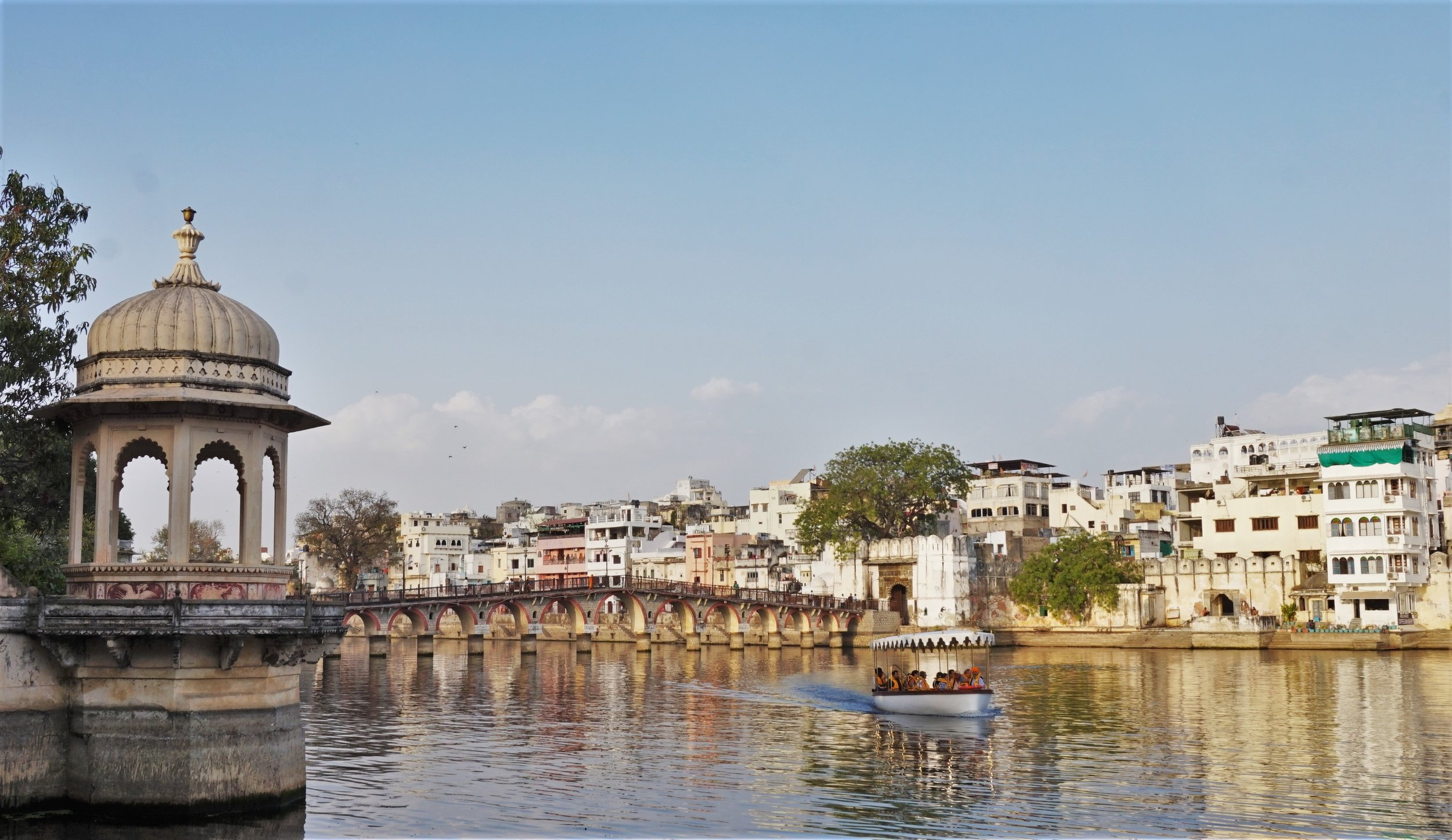 Take a trip with the boat on the lake at sunset is one of the best things to do in Udaipur. The view from the other side of the lake is one of the best places to visit in Udaipur.