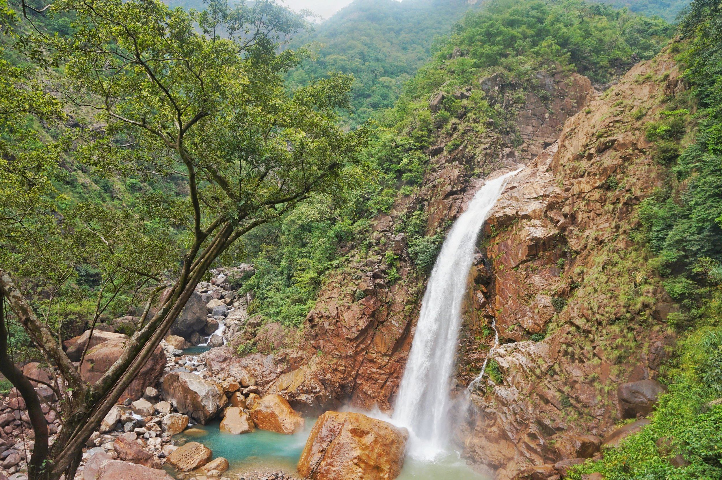 The Rainbow Falls near Nongriat are one of the best places to visit on your backpacking trip in Meghalaya.