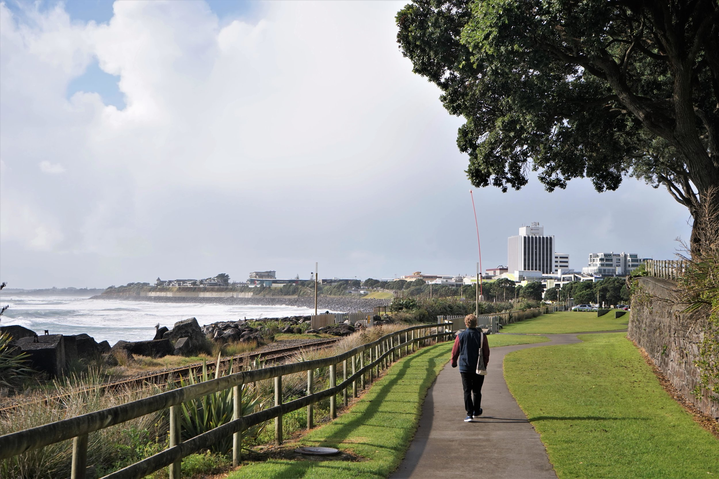Walking the coastal walkway in New Plymouth on a sunny day.