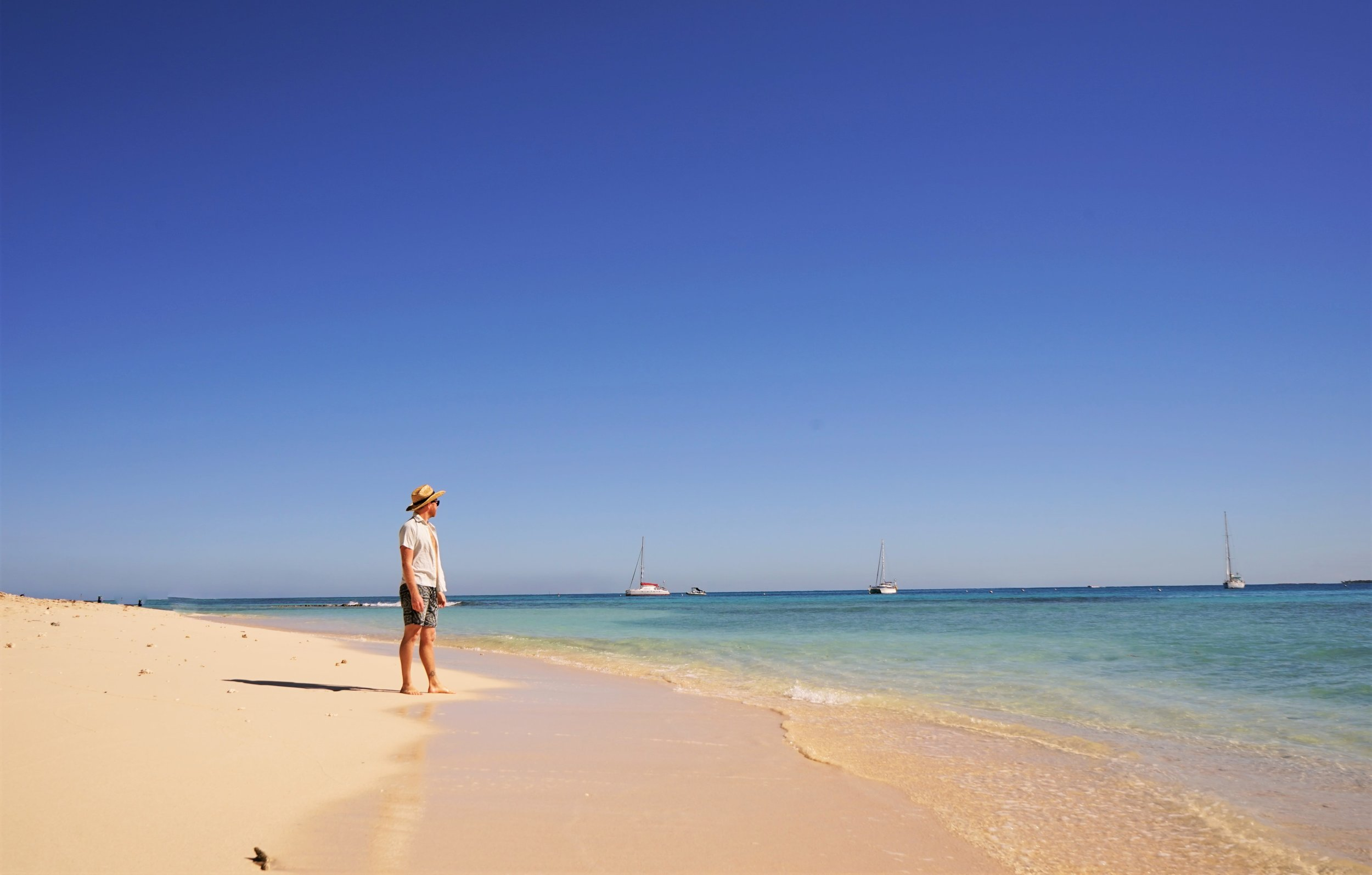 Relaxing on the beautiful sand beaches is one of the best things to do in New Caledonia.