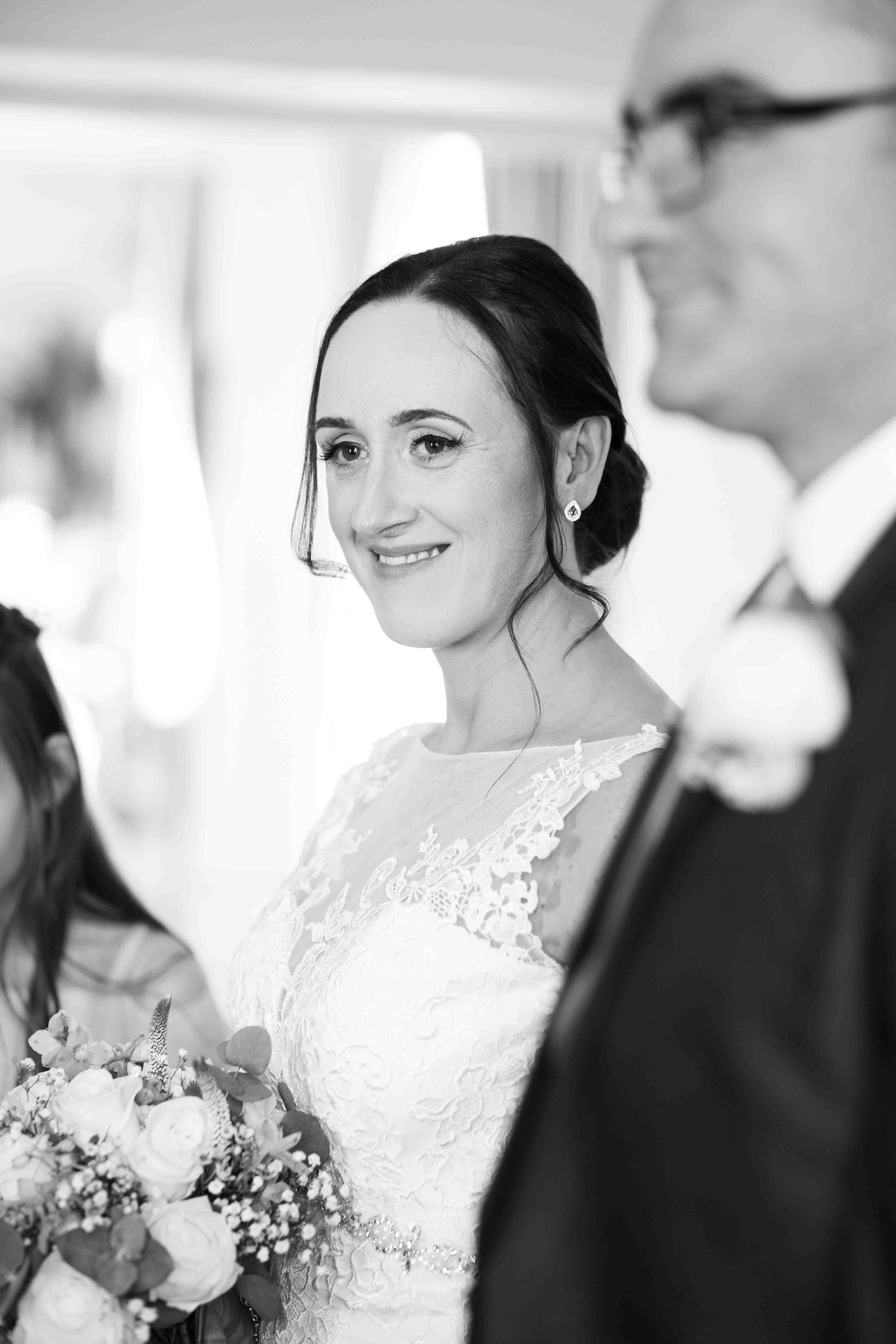 wedding-photos-willenhall-wedding-photographer-wolverhampton-wedding-photographer-west-midlands-wedding-photographer-birmingham-bride-vows-smile.jpg