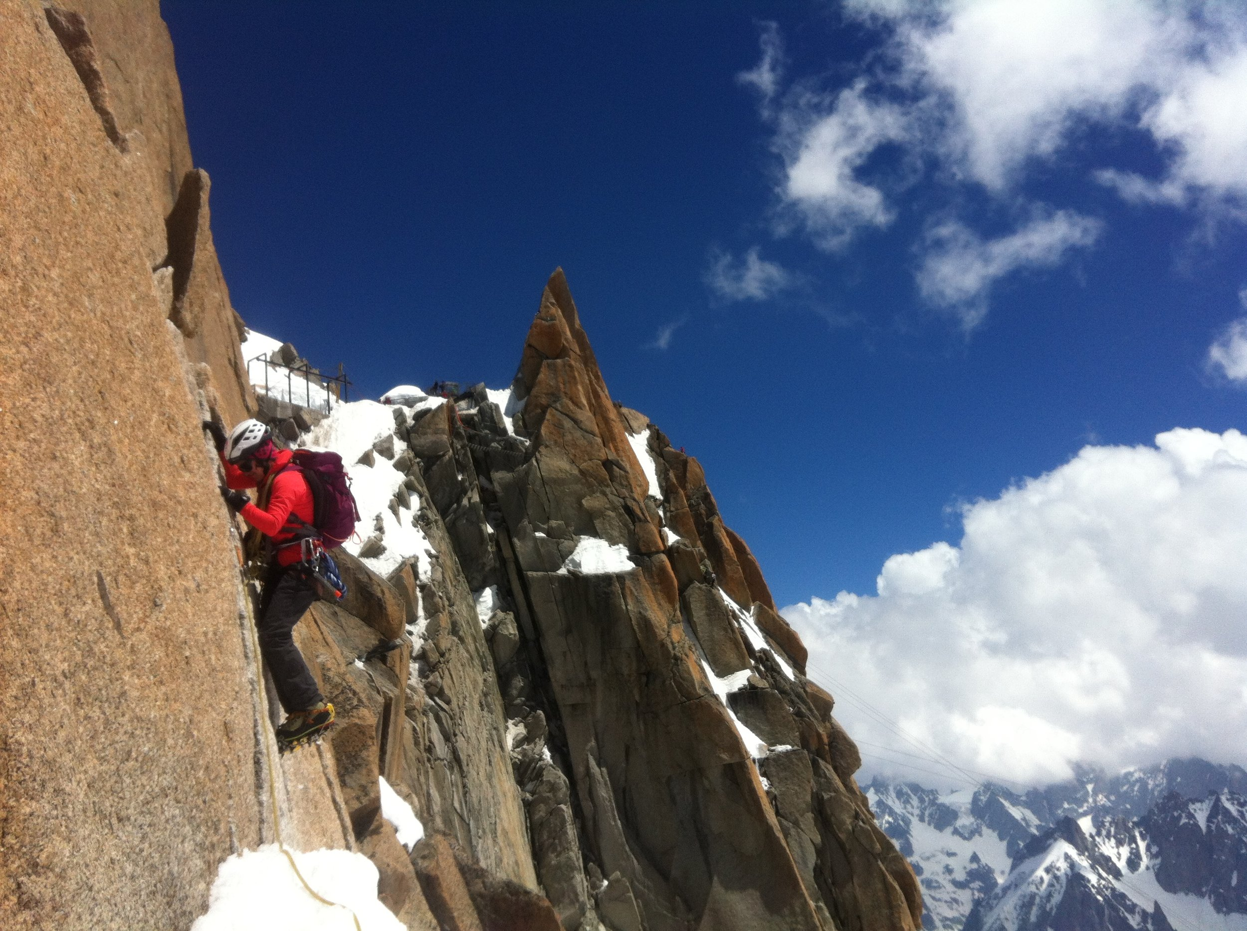 Heather Swift showing me how to climb rock in crampons on the Cosmique Arete
