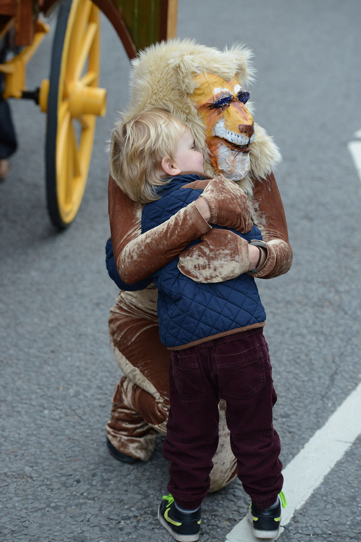 Walkabout and Street Theatre Performers with Costumes: Lion hugging child