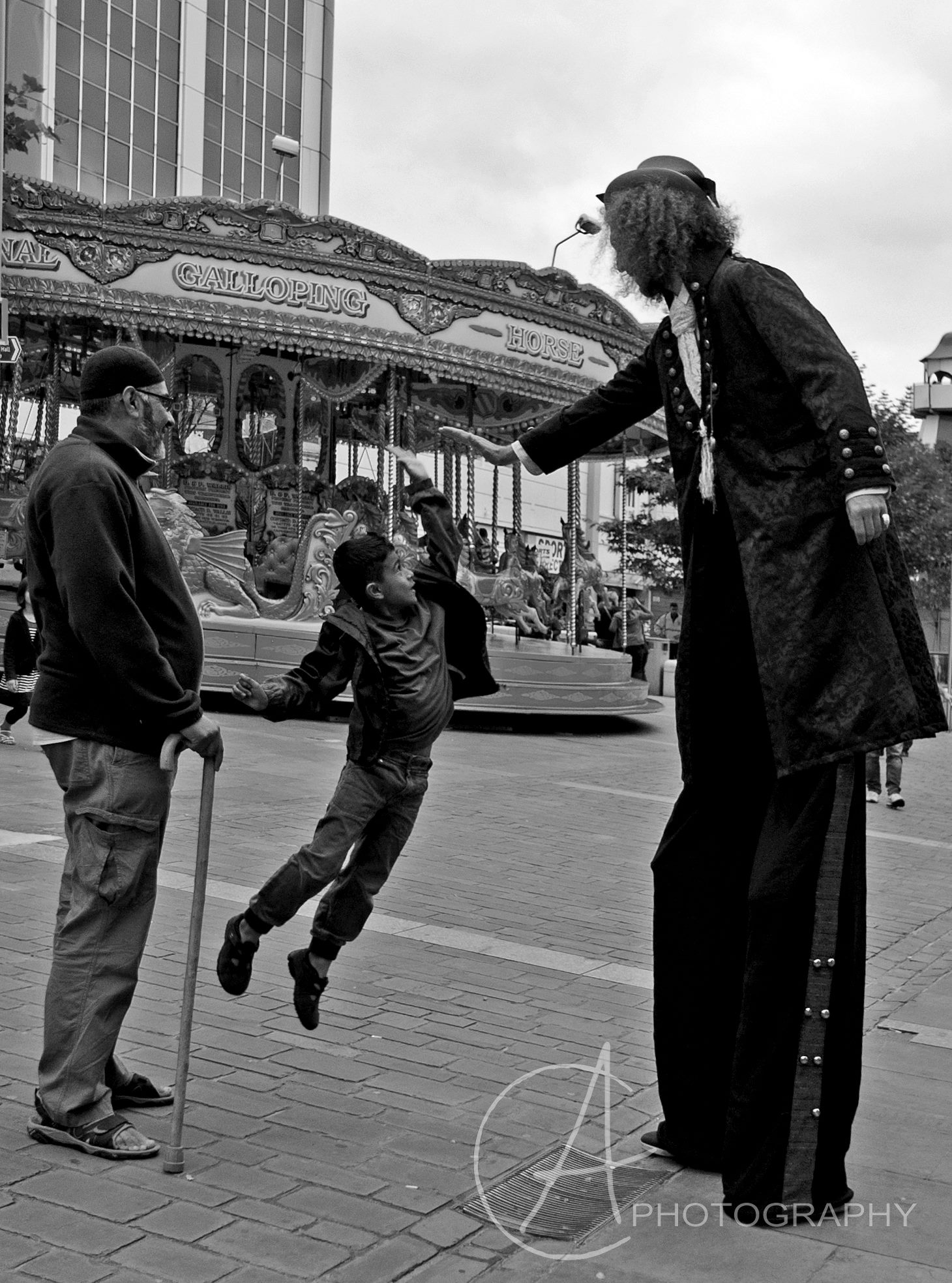Walkabout Circus Performers and Street Theatre: Stilt walker high five