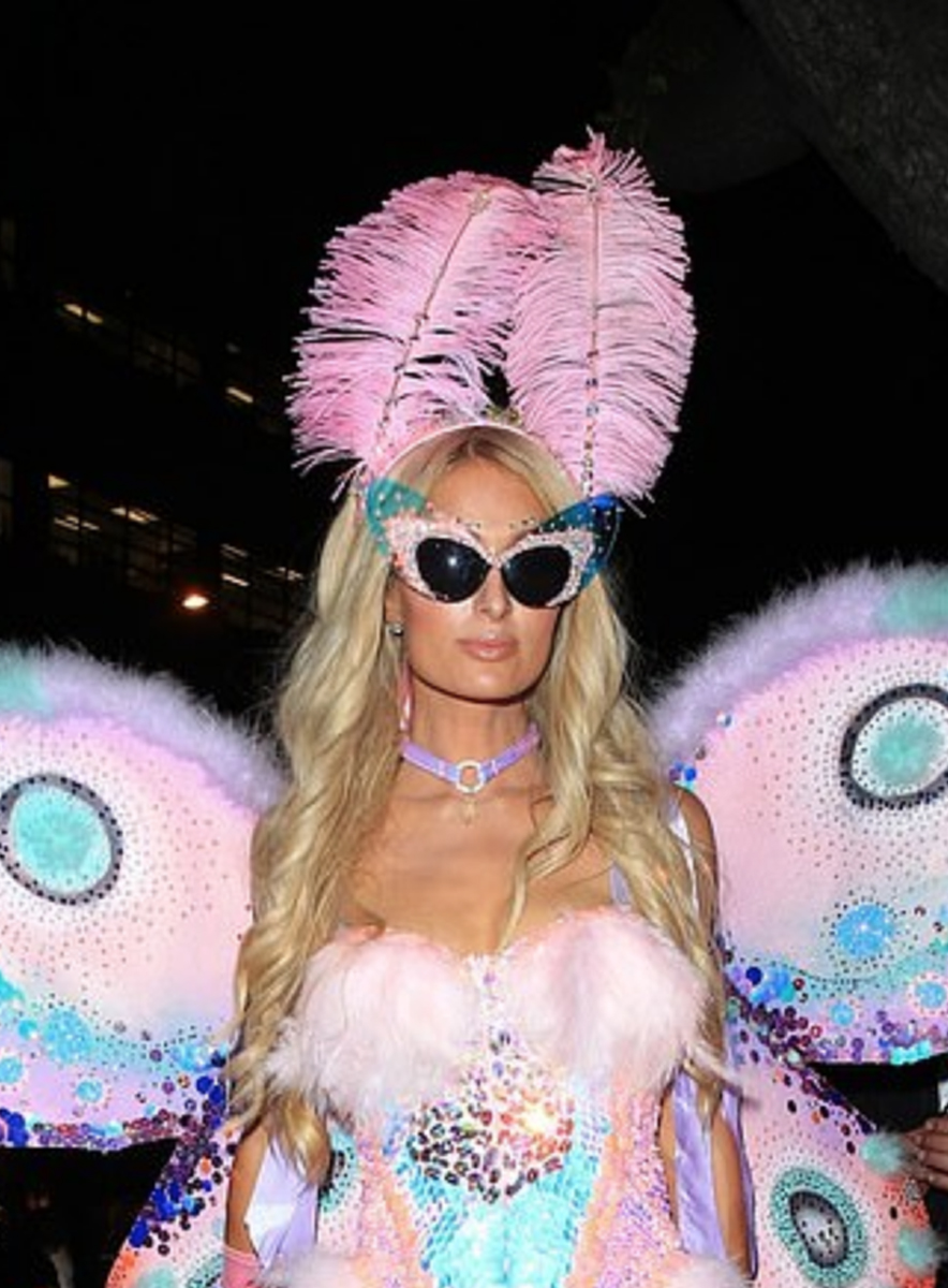 Portrait in a hat with pink feathers,  Paris Hilton, 2018