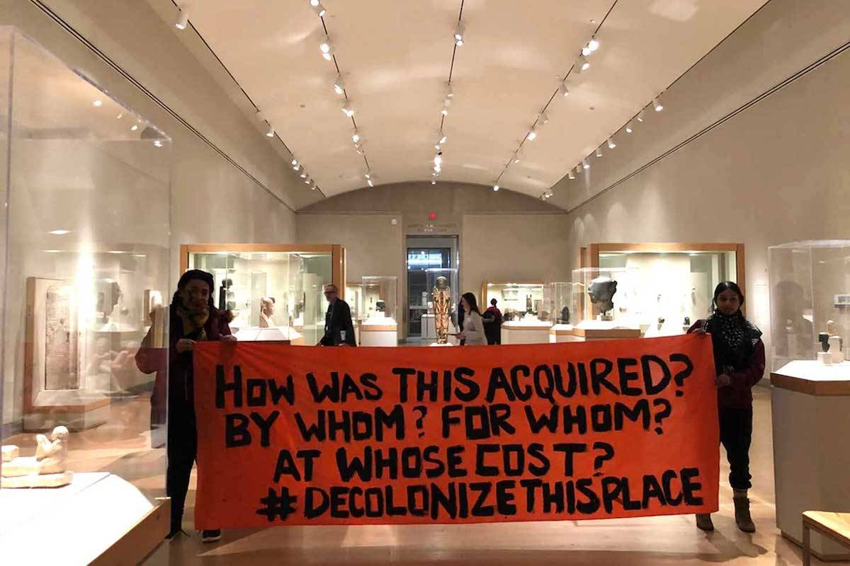 Decolonize this Place activists protesting in the Brooklyn Museum