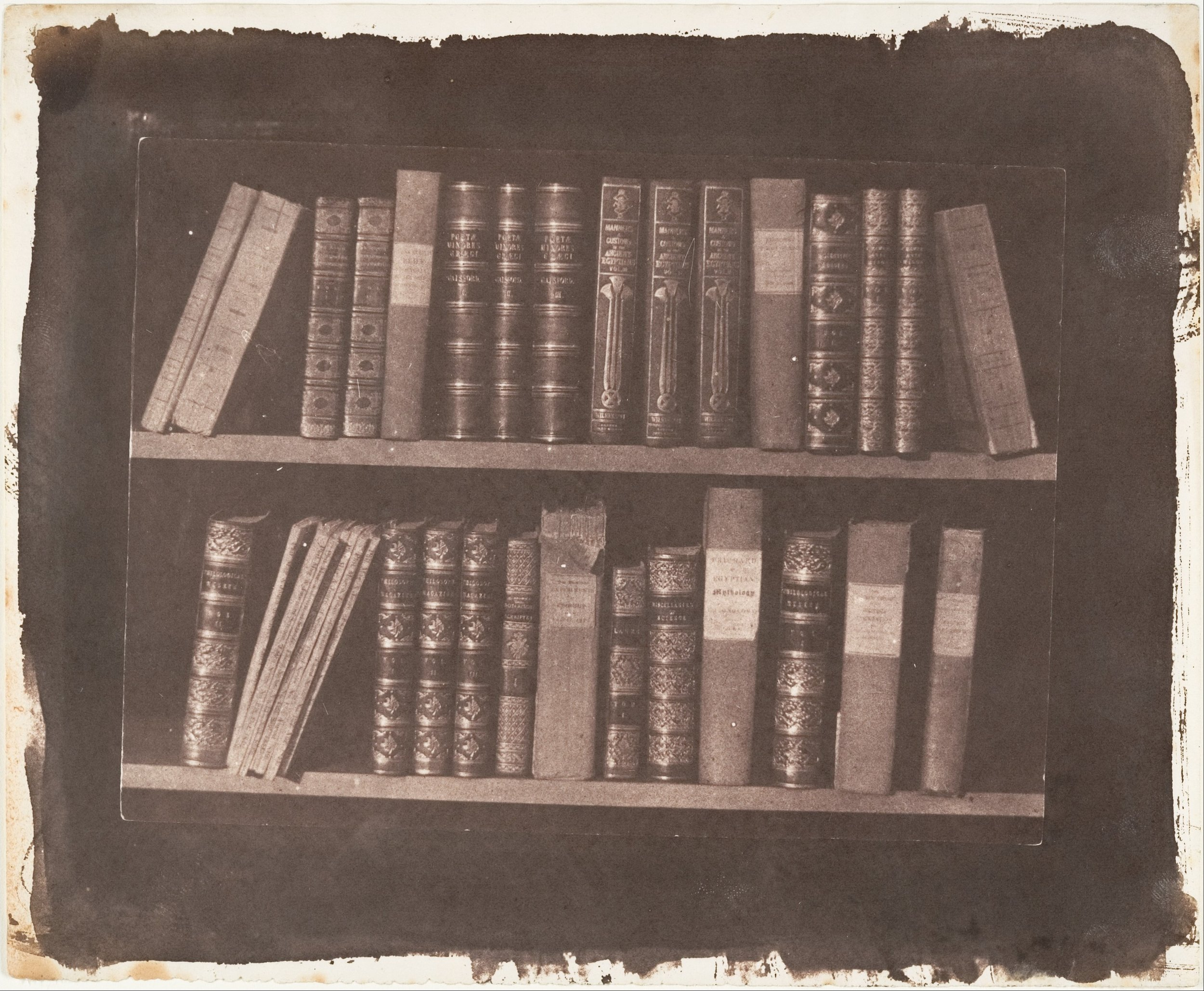 William Henry Fox Talbot (British, Dorset 1800–1877 Lacock).  A Scene in a Library . Before March 22, 1844. Salted paper print from paper negative. Image: 13.3 x 18 cm (5 1/4 x 7 1/16 in.). The Metropolitan Museum of Art. Gilman Collection, Gift of The Howard Gilman Foundation. 2005.100.172.  https://www.metmuseum.org/art/collection/search/283066