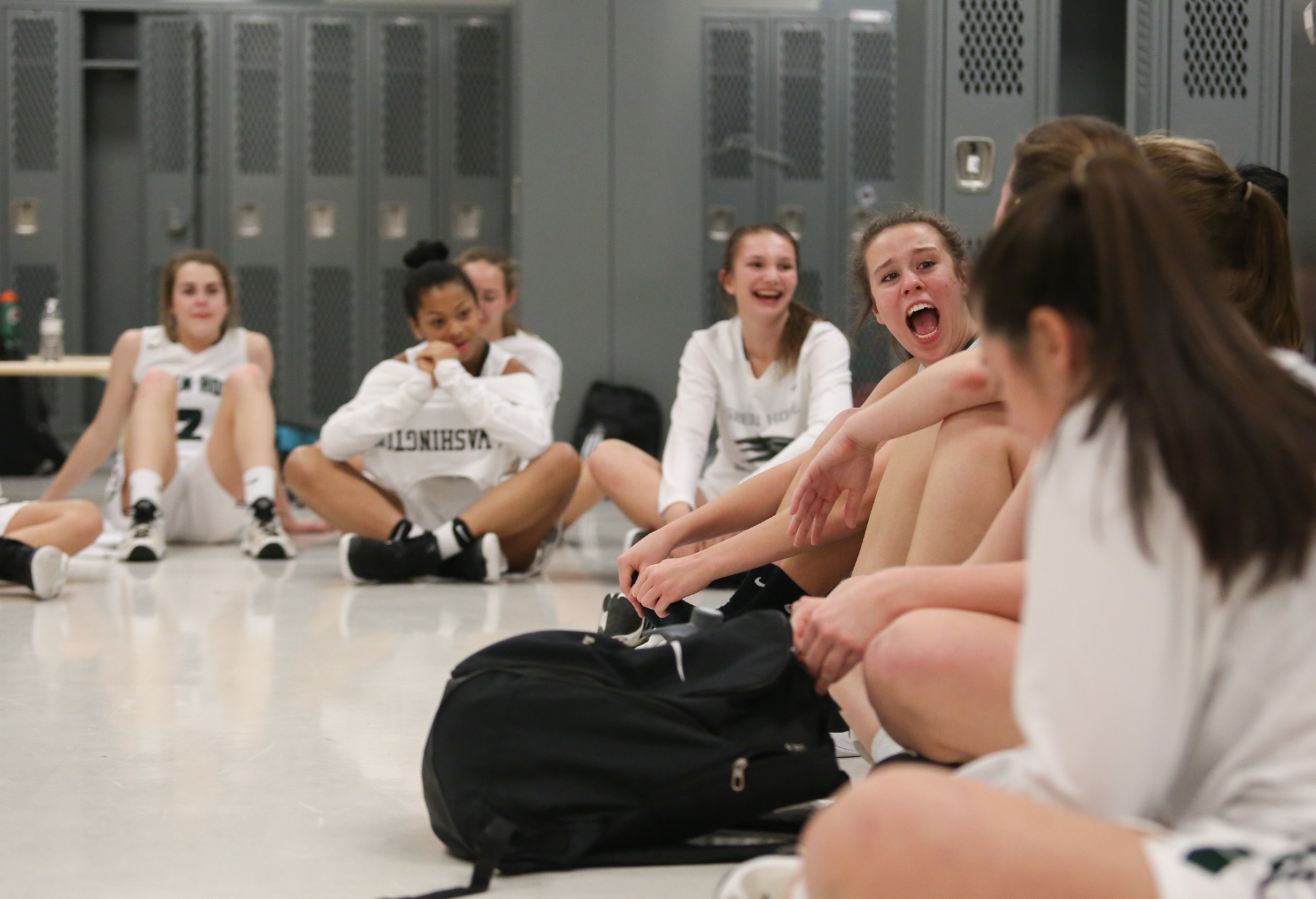Green Hope girls celebrate the conference tournament championship after winning Holly Springs at Apec Friendship High School locker room on Feb.17, 2017.