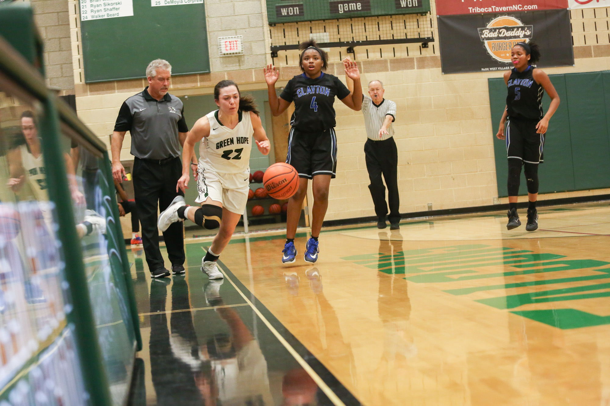 Clayton's No.4 player freezes at a moment worrying about the foul pushing Green Hope's Kelly Fetzgerald and the ball out of bounds during the second half of game on Feb.22, 2017. Green Hope won, 58-35.