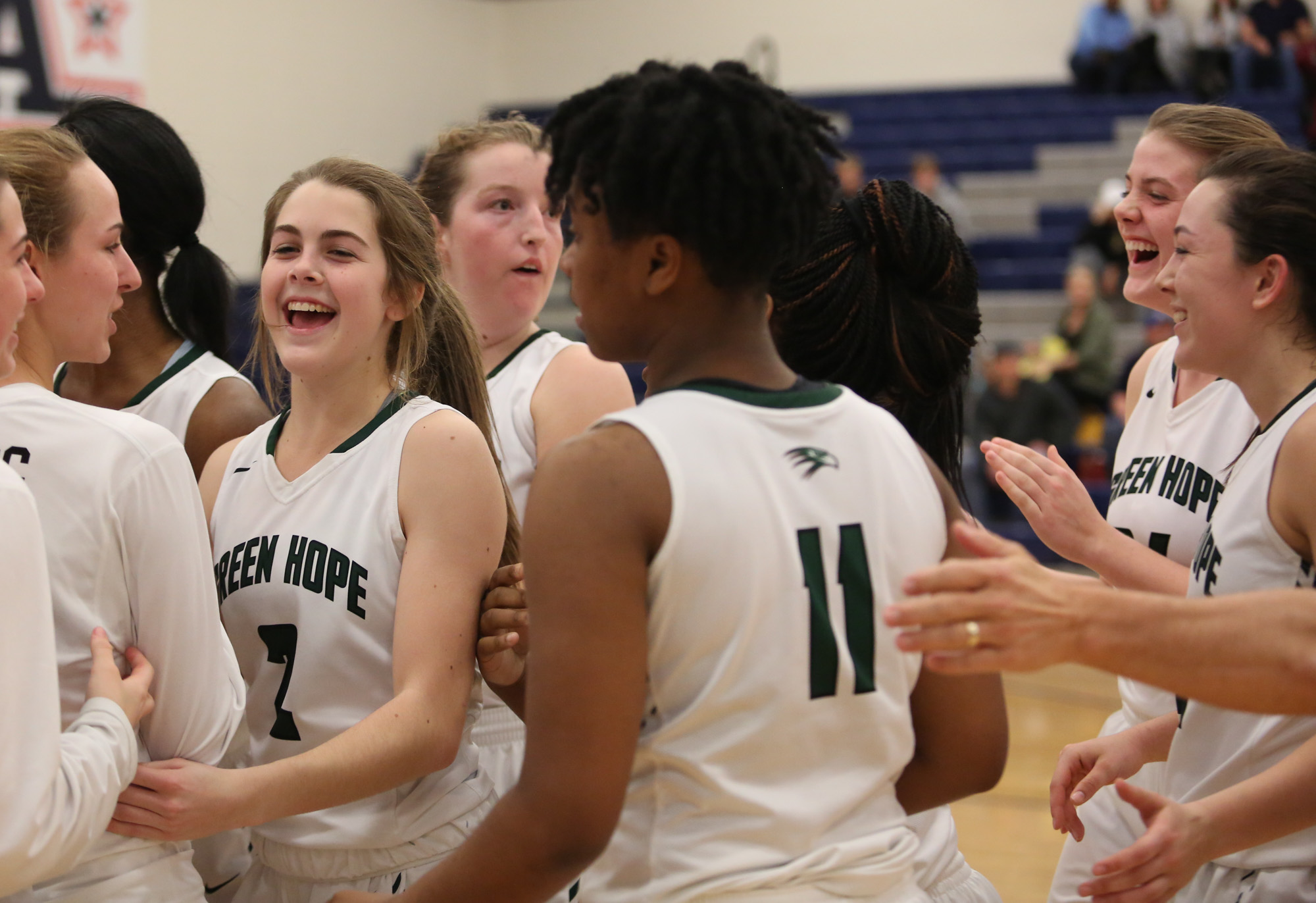Green Hope girls celebrate after they won against Holly Springs, 50-49, for the Conference Tournament Championship on Feb.17, 2017.