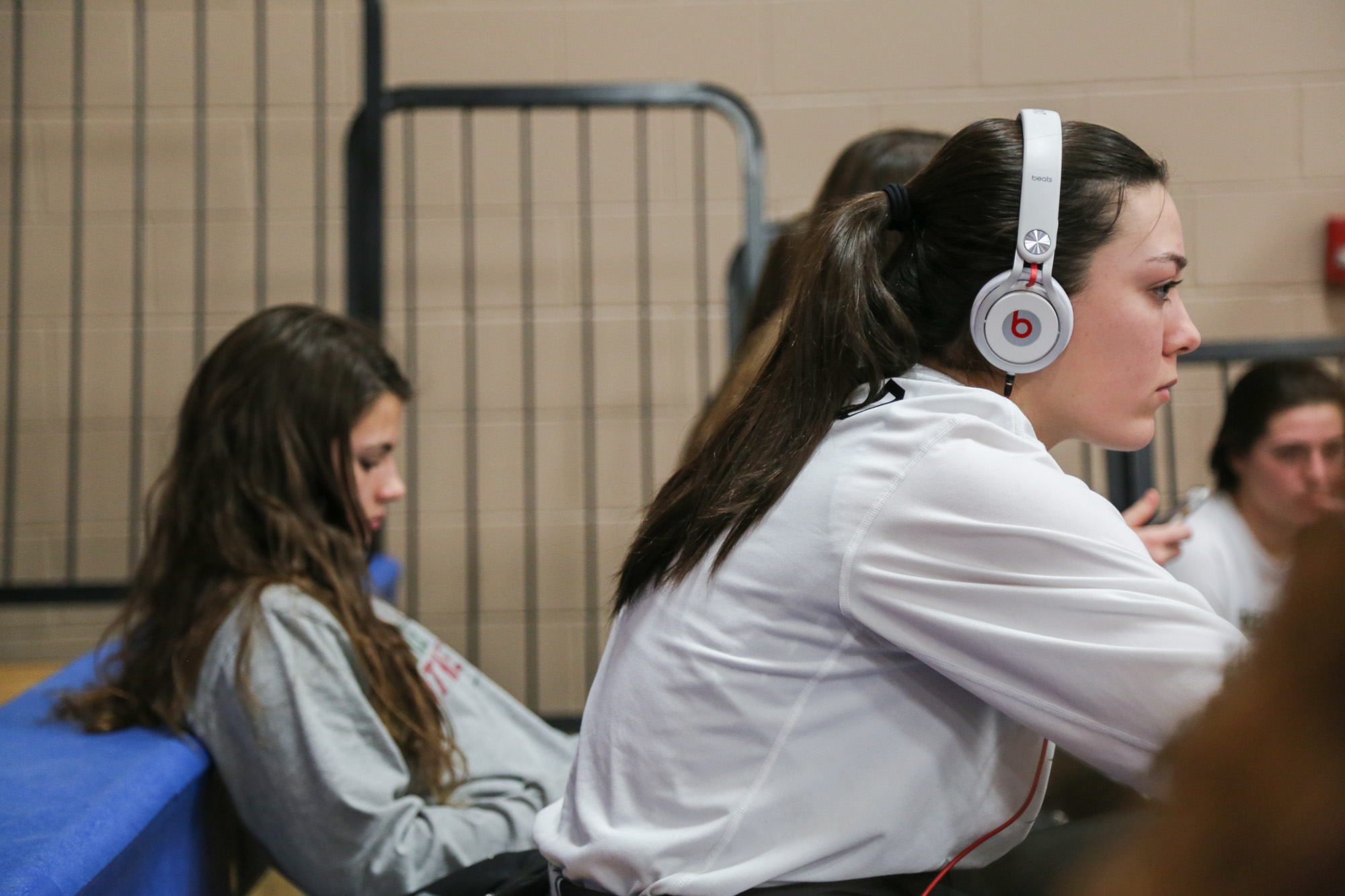Green Hope's Kelly Fitzgerald and Emily Wynne watch the men's varsity game chilling before their game with Athens Drive on Feb.10, 2017.