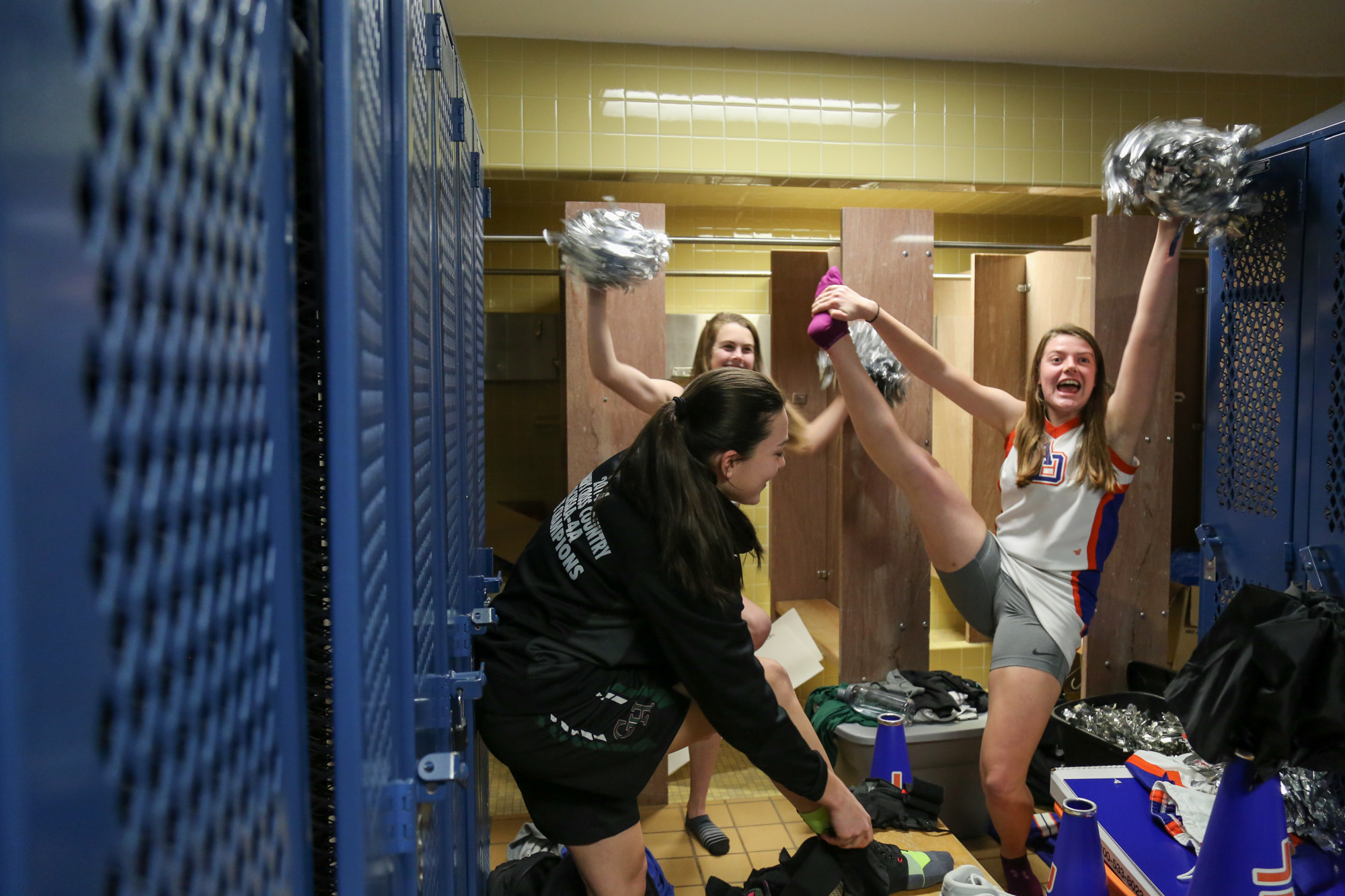 Green Hope's Emily Schoeffler and Catherine Holbrook dance for fun in the locker room before their game with Athens Drive High School on Feb.10, 2017.