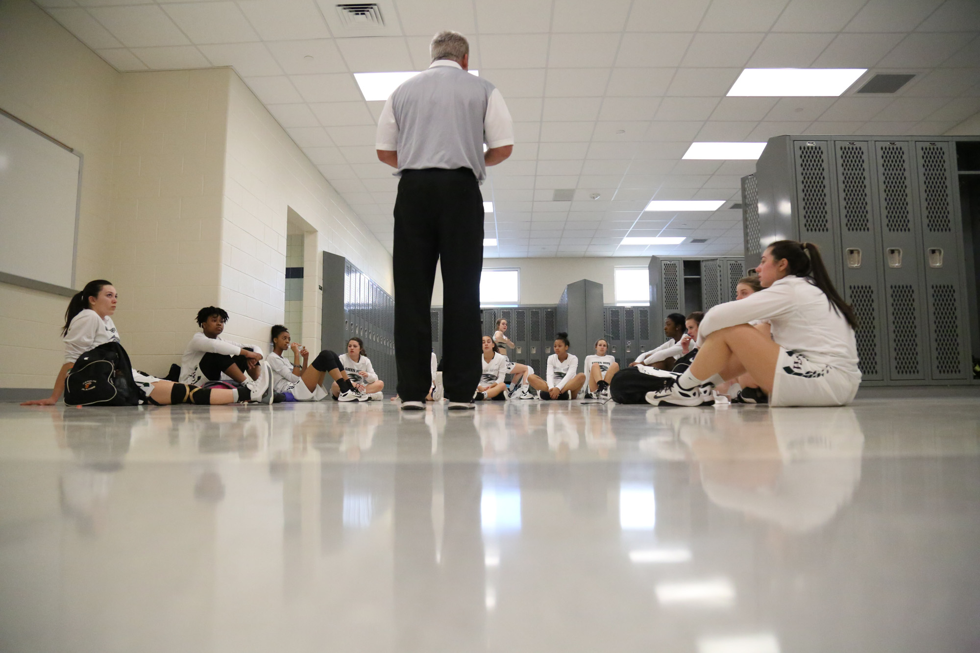 Green Hope's coach Mike Robinson gave instructions to the team in the locker  room before the game against Holly Springs on Feb.17, 2017.