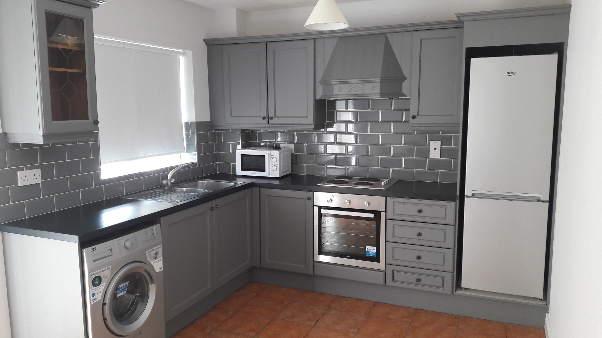 Grey kitchen with grey subway tiles.jpg