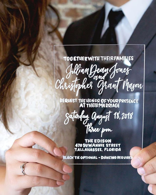 Loving the way @alyssaforbesphoto captured this acrylic invite I did for a fun, urban themed shoot 😍 Have lots of pictures to share (bc honestly my focus has been on everything but social media) so keep an eye out. List of local vendors below! . Also, is it Friday yet?? . . . . 📷Photographers: @alyssaforbesphoto @haleyfillmonphotography 📍Venue: @edisontally 🖋Calligraphy: @cobalthuecalligraphy 👰🏻🤵🏻Gown & Attire: @whiteweddingstallahassee 💍Jewelry: @shopellemarket 💇🏼‍♀️Hair: @erinstonerstylist 👛Makeup: @hausofbeautytallahassee 🌿Florals: @missygunnels 🛋Rentals:  @terrismithdetails 🐕Day-of Pet Care & Chauffeur: @simplypawfectweddings 🍰Cake: @katiescakesandcatering