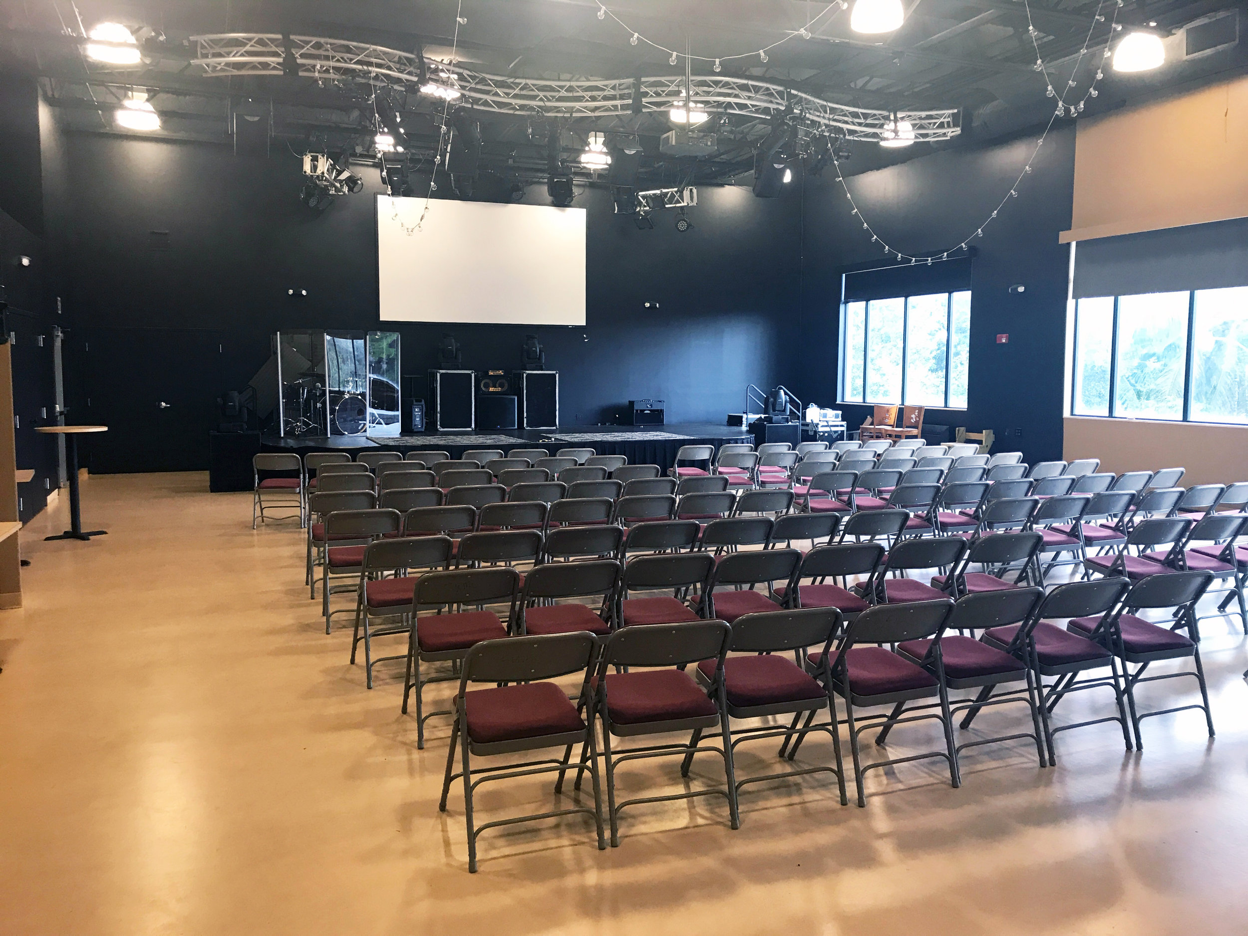 2nd Floor Space (Faith Building) - 2 sides - Sq ft.: 1778 (worship side), 1674 (mtg side)Capacity:135 ppl at tables & 180 ppl in chairs (eachside);whole room, 300 ppl at tables & 400 ppl inchairsFeature:Worship side has a stageTV/DVD/Computer: YESSound System: YES