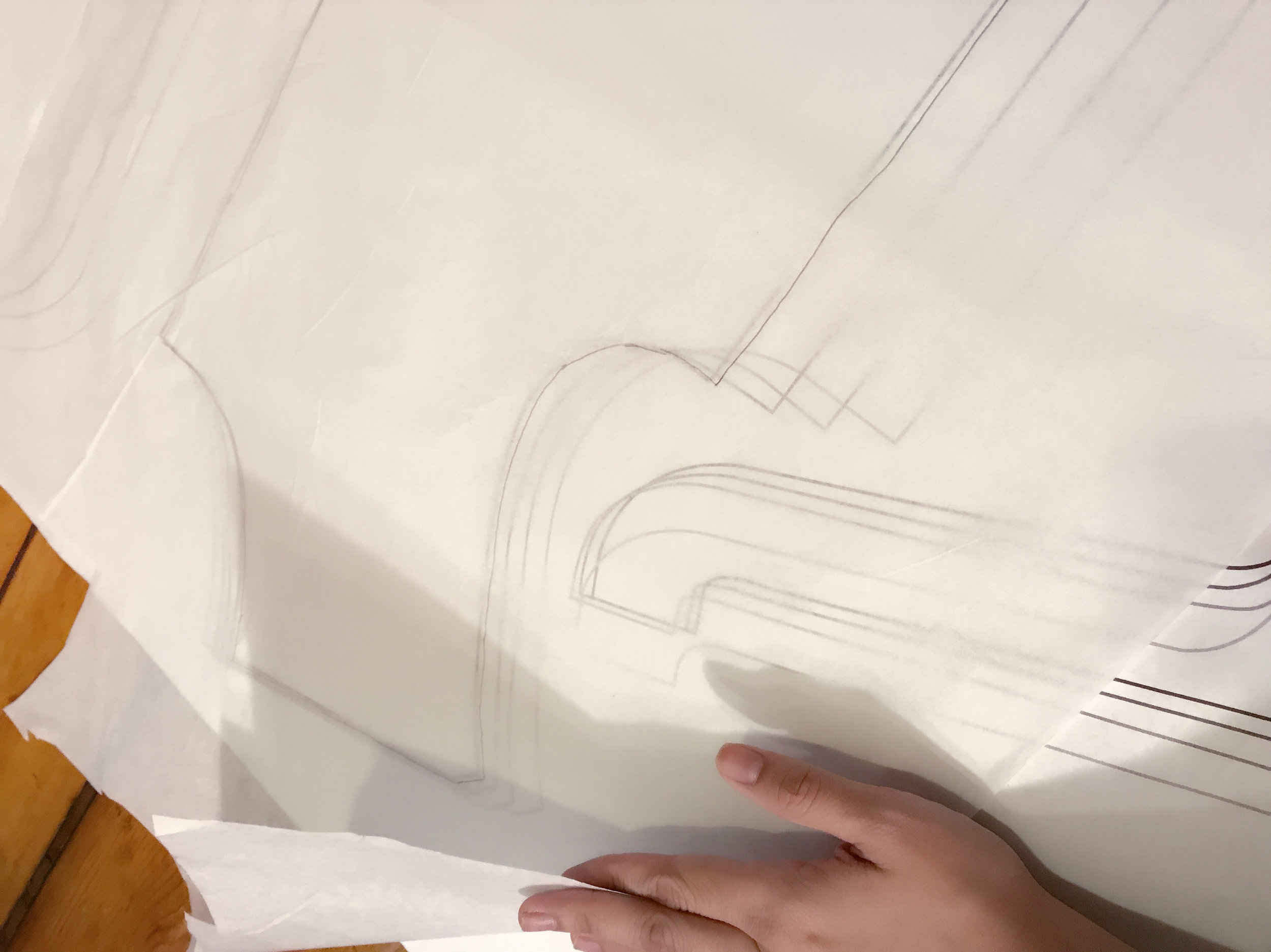 Tracing the original pattern on tissue paper