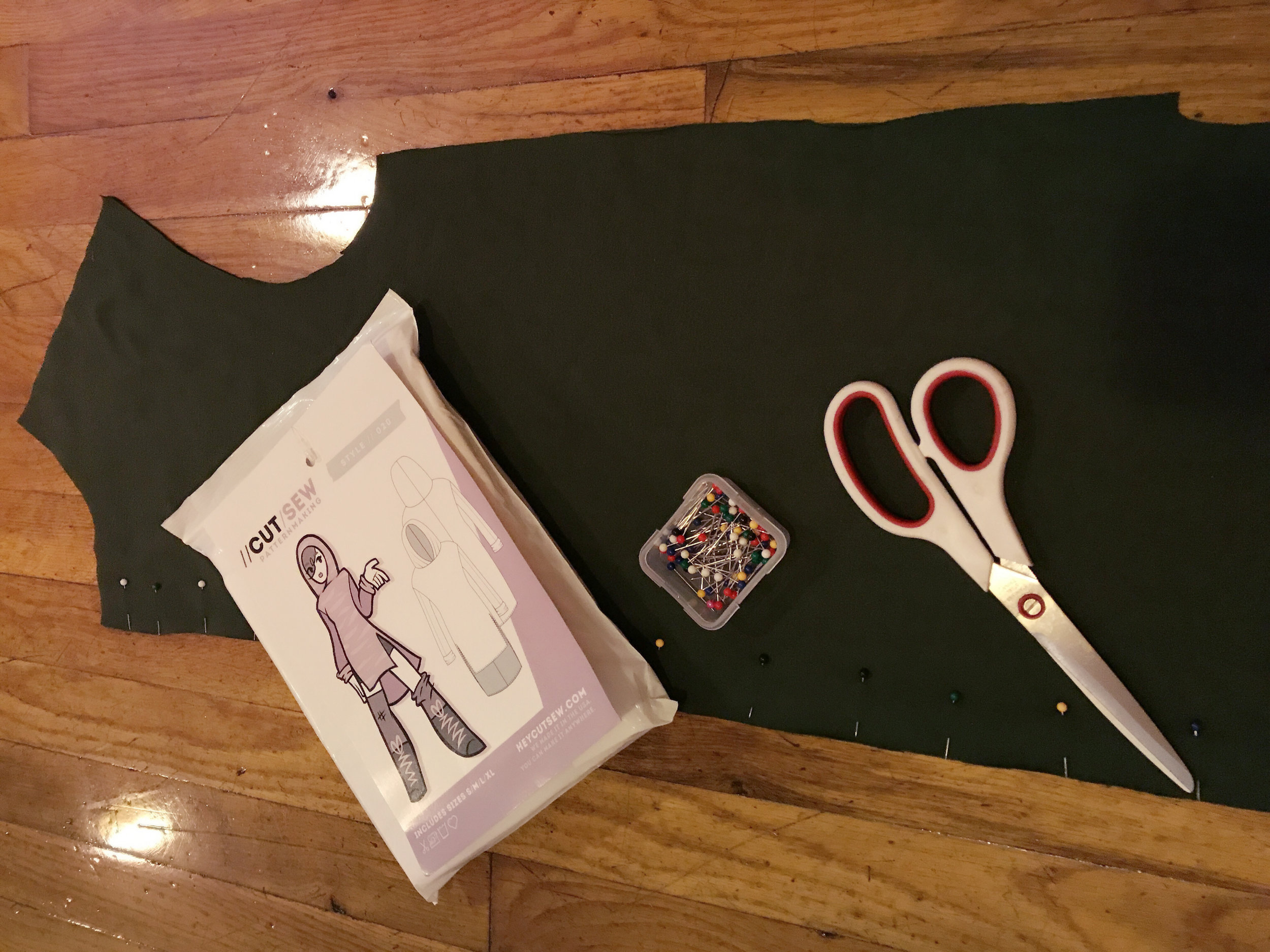 My shears and ballpoint pins with the fabric I cut out from the pattern