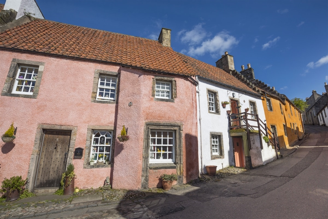Culross , Fife. The traditional pantiles ('s' shaped roof tiles) visible on the roofs of many coastal buildings were in fact ballast from returning trade ships, following the transportation of Scottish coal to Europe. Historical and cultural threads can inform modern interpretations and help instruct the tapestry of design.