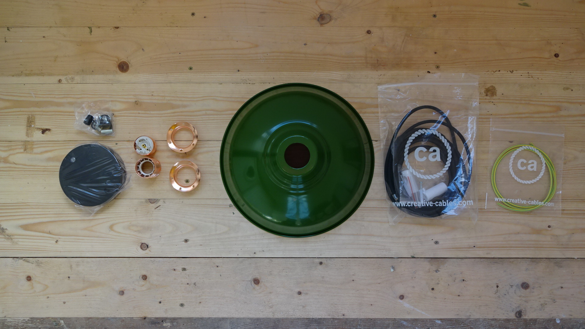 Fittings from L to R: 2 way black, metal rose, lamp holder and fittings, green enamel pendant shade, black raylon flex, earth sheathing