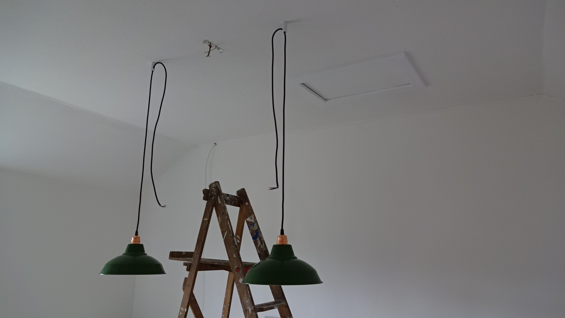 y) The pendants were held in place by the ceiling cable clamps to allow us to make sure the flexes were equal length and to make it easier when making the connections to the mains