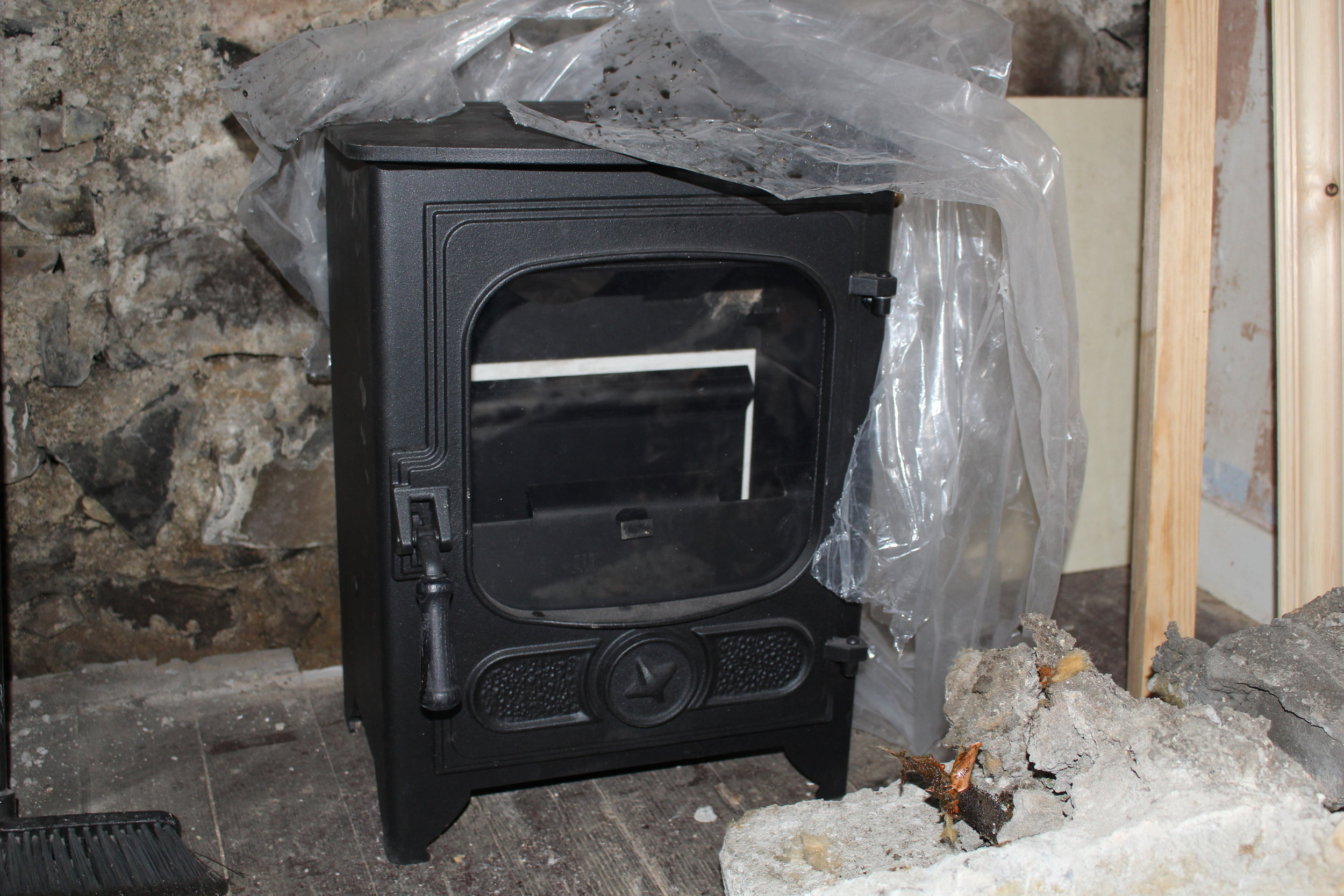 We purchased a 5kW multifuel stove, flue and all fittings from Alex at  Bonk and Co.  in Inverness. We felt the heat output would be sufficient for the space and it also keeps building regulation requirements simpler than a bigger stove. We wanted the stove to be capable of burning peat as well as wood.