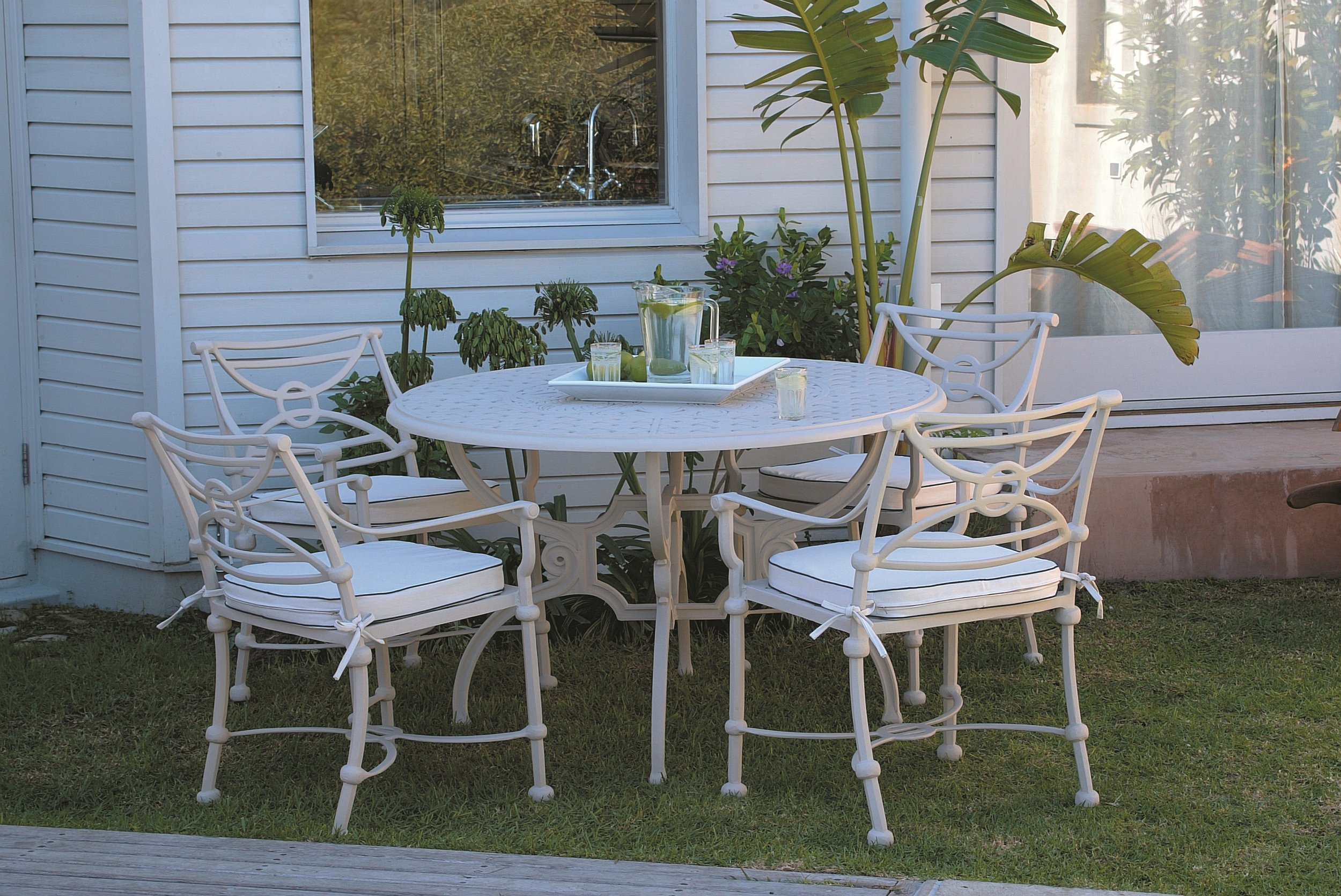 Soriano 4 seater table and Baxter carvers