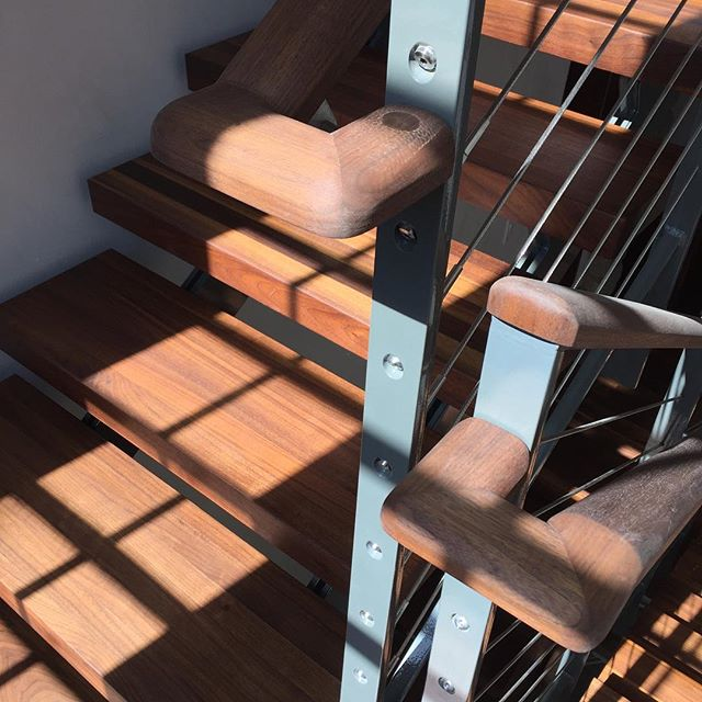 Beautiful walnut and steel handrail design by Burgess Rome Architects for our residential project in Boulder.