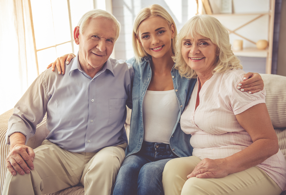 Daughter with her old aged parents