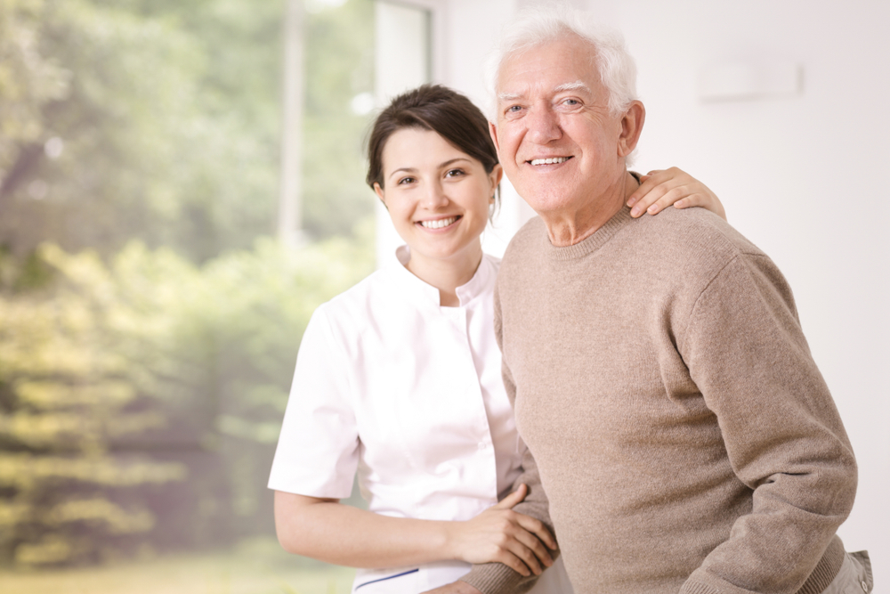 Lady Caregiver With An Old Man
