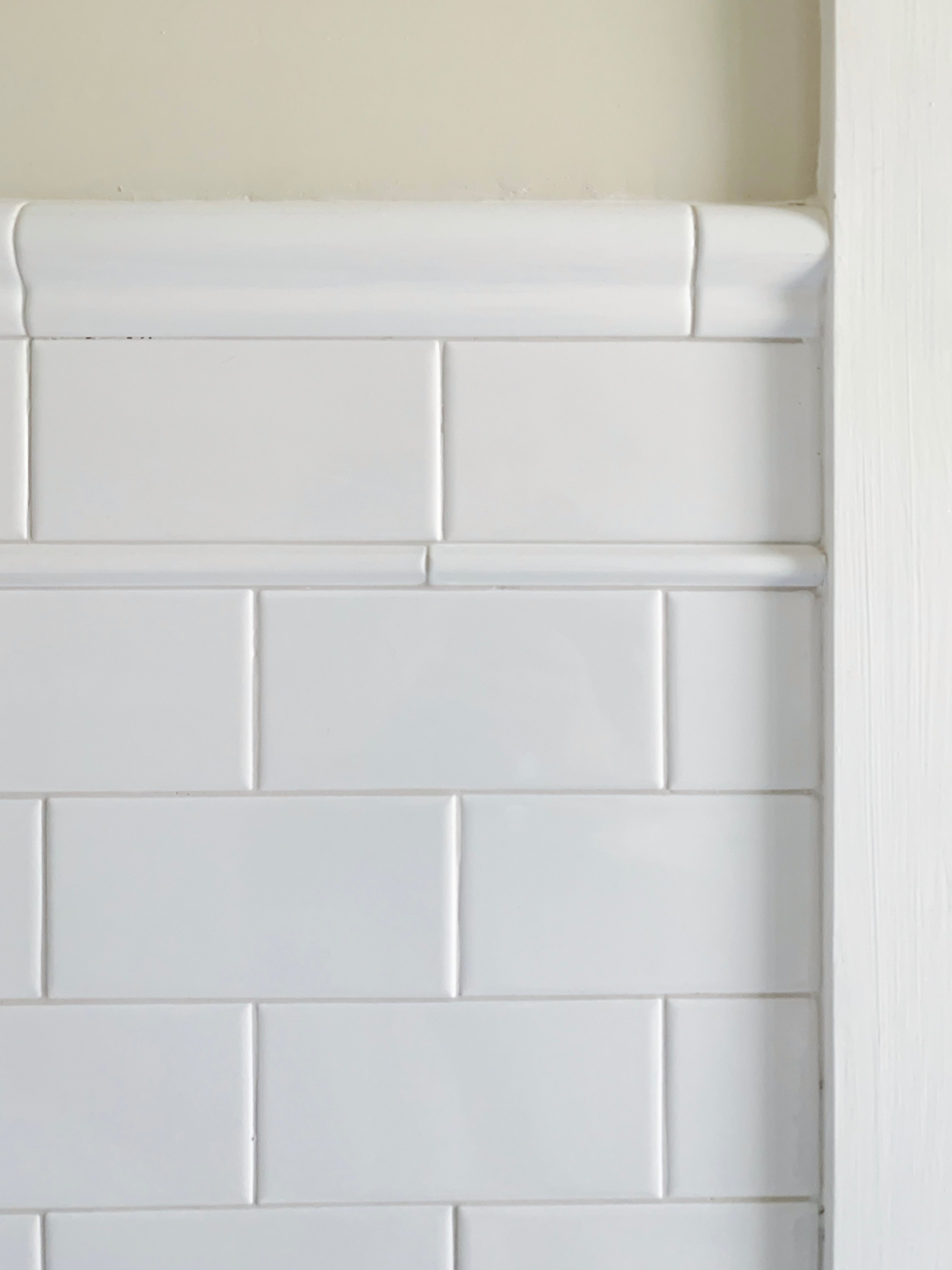 Subway wall tile  |  Pencil tile  |  Chair rail  |  Base cove tile  |  Grout: Mapei FROST unsanded grout