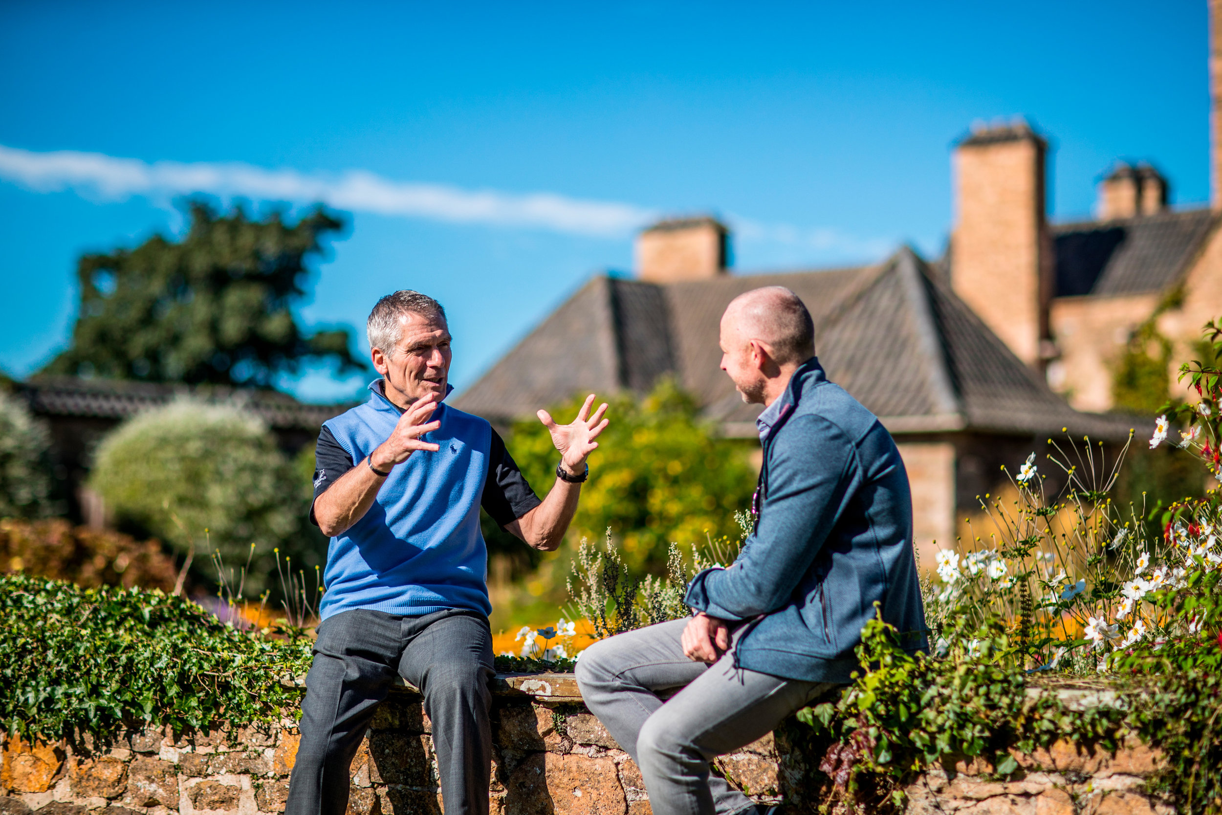 Charlie with a client in a beautiful outdoor setting