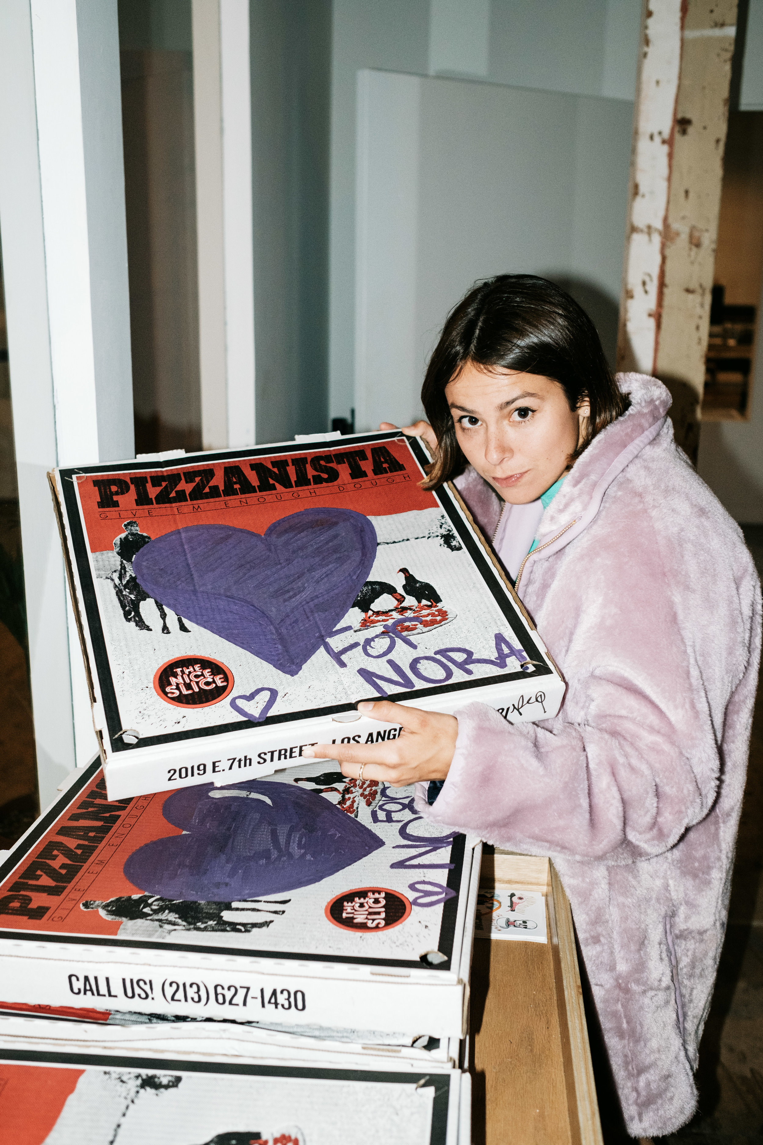 Nora and her customized pizza box.