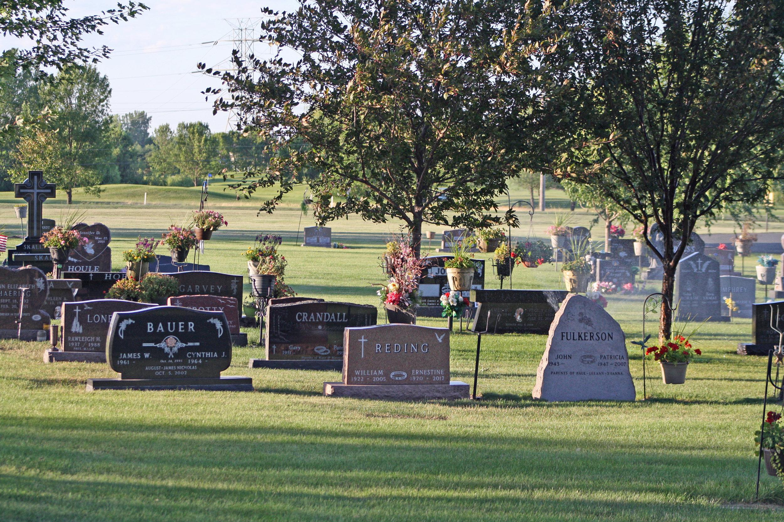 Gravestones in a cemetery in the sunlight