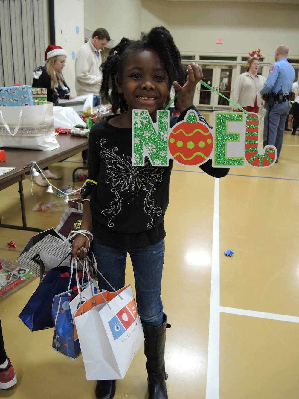Children's Program Participant Shopping for Christmas Gifts for Her Family.