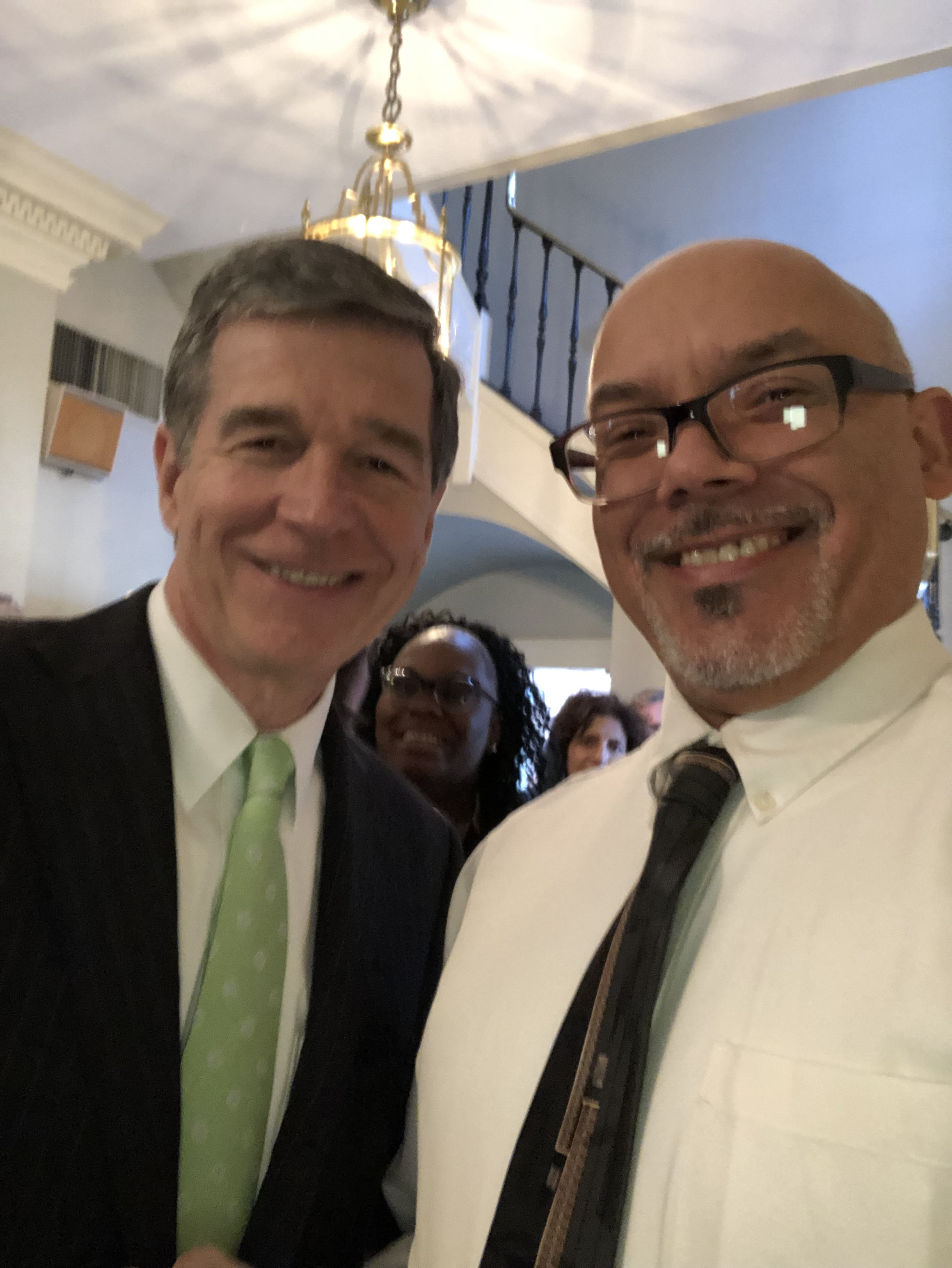 Timothy Johnson, Alumnus, with Governor Roy Cooper after speaking at StepUp Sunday.